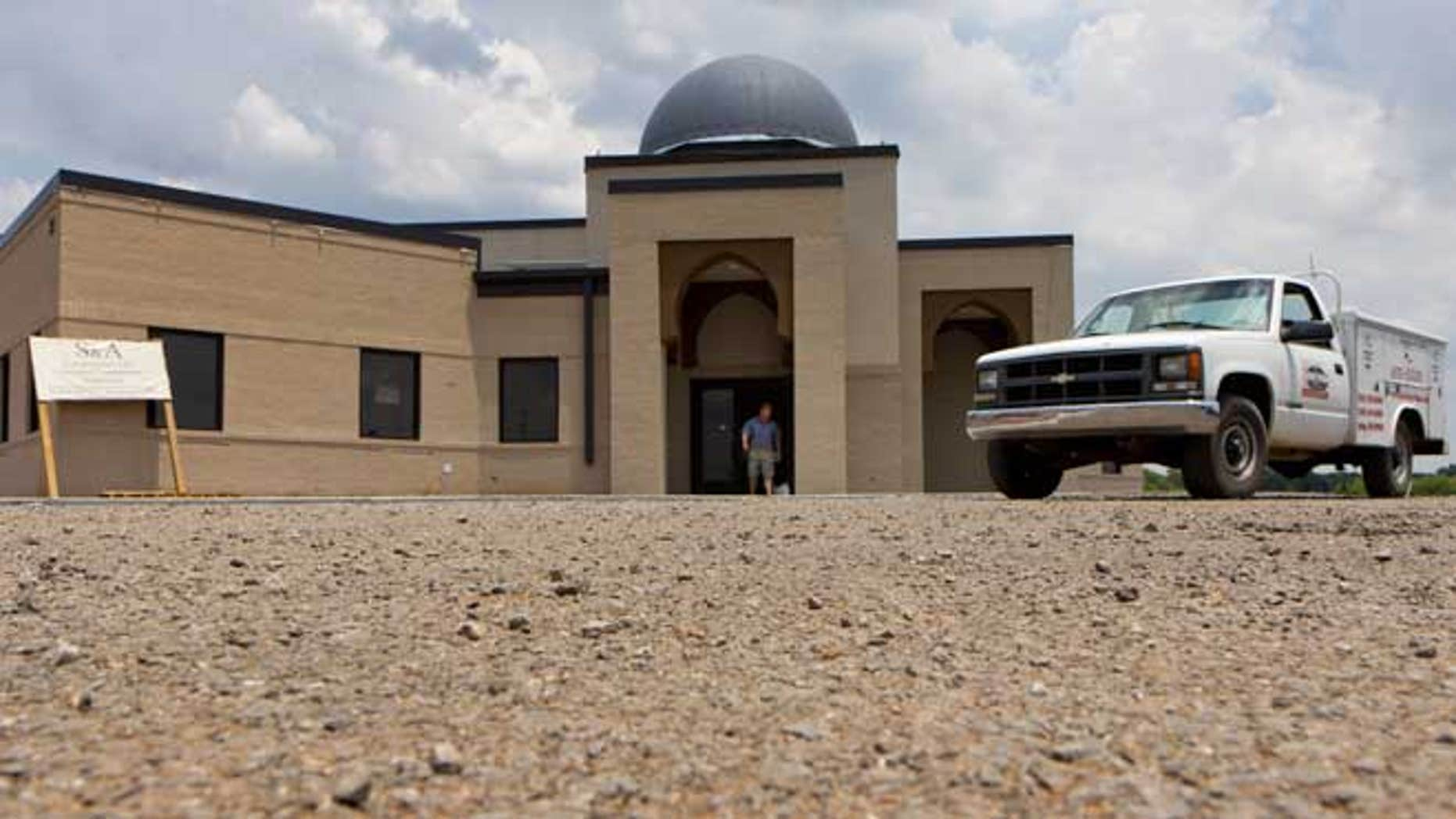 In a Thursday, June 21, 2012 file photo, a worker walks out of the construction site of a mosque being built in Murfreesboro, Tenn.