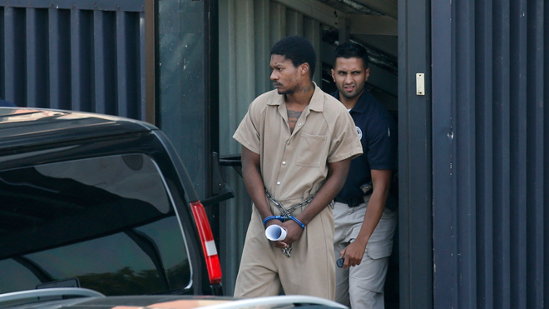 Emanuel Lutchman is transported out of a Federal Building on Thursday, Aug. 11, 2016, in Rochester, N.Y. Lutchman pleaded guilty Thursday to conspiracy to support the Islamic State.
