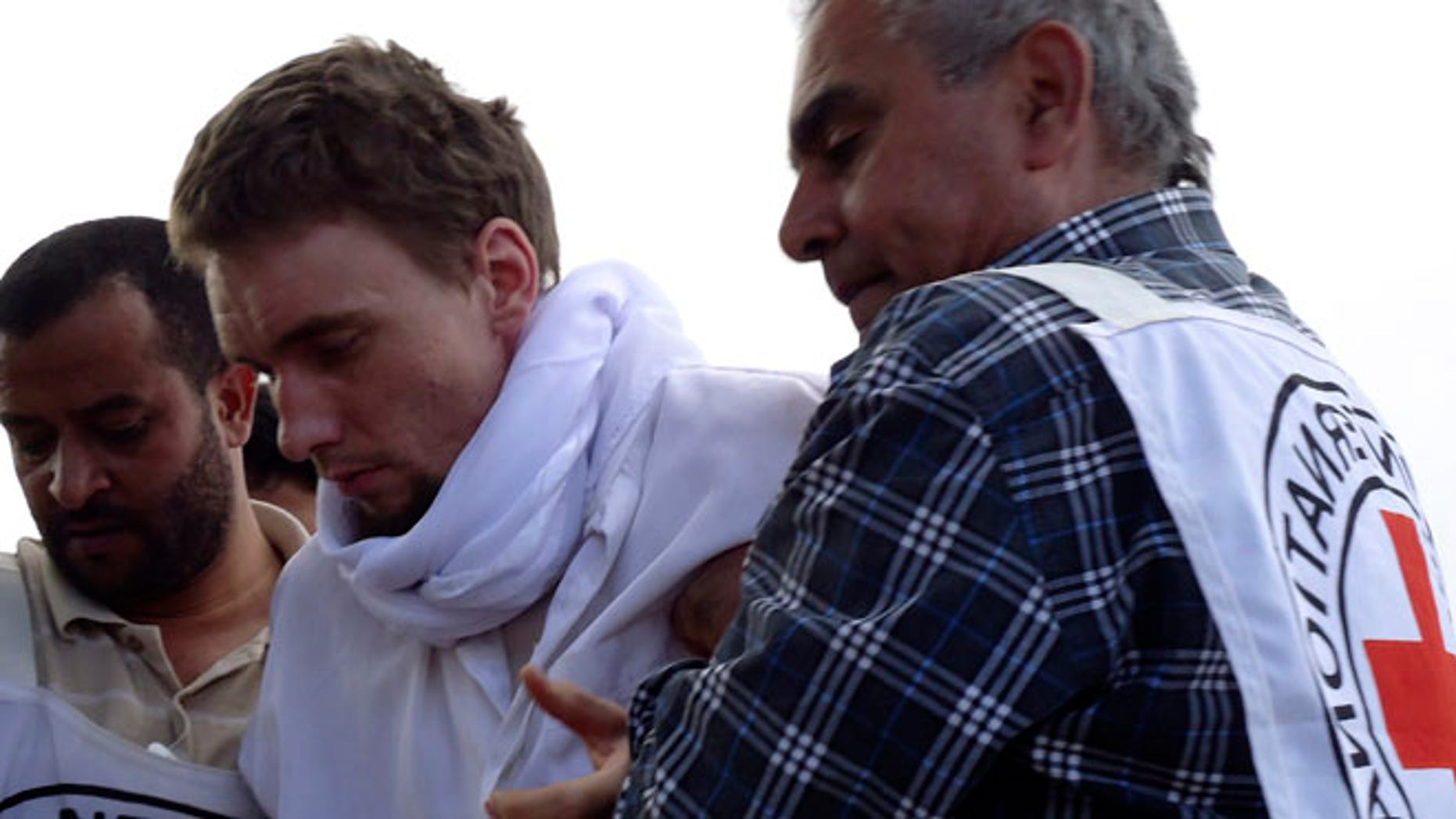 FILE: Nov. 14, 2013: Red Cross medics help a man wounded in fighting at the Saada airport in Yemen, where instability has already helped Al Qaeda militants to take root.