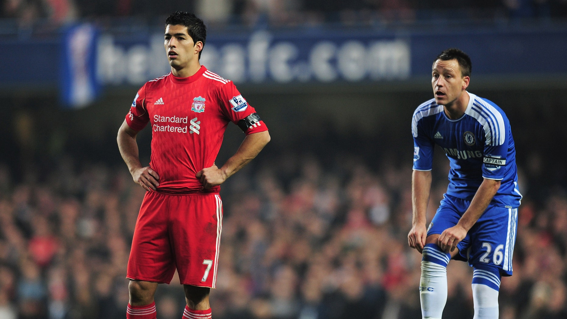 LONDON, ENGLAND - NOVEMBER 20: Luis Suarez of Liverpool looks on with John Terry of Chelsea during the Barclays Premier League match between Chelsea and Liverpool at Stamford Bridge on November 20, 2011 in London, England.  (Photo by Shaun Botterill/Getty Images)