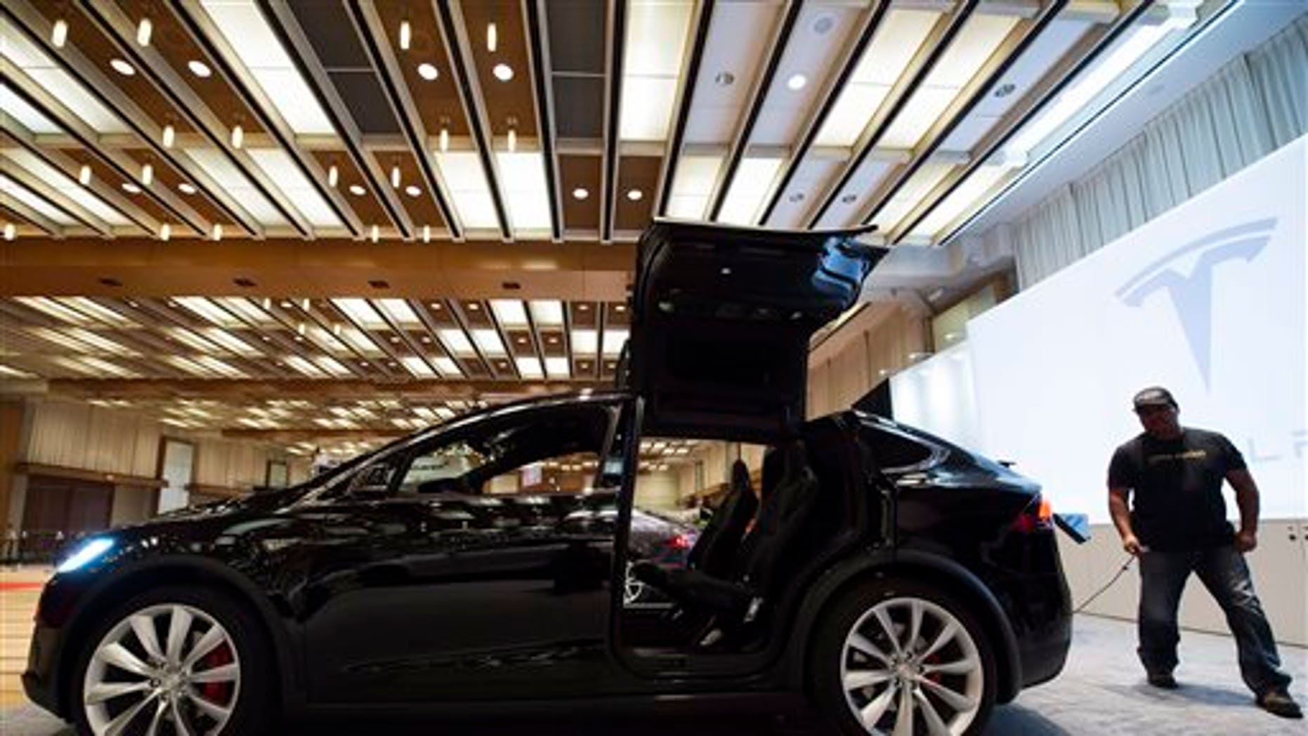 The Tesla Model X is shown at the 2016 Canadian International Autoshow in Toronto on Feb. 11, 2016. (Nathan Denette/The Canadian Press via AP)