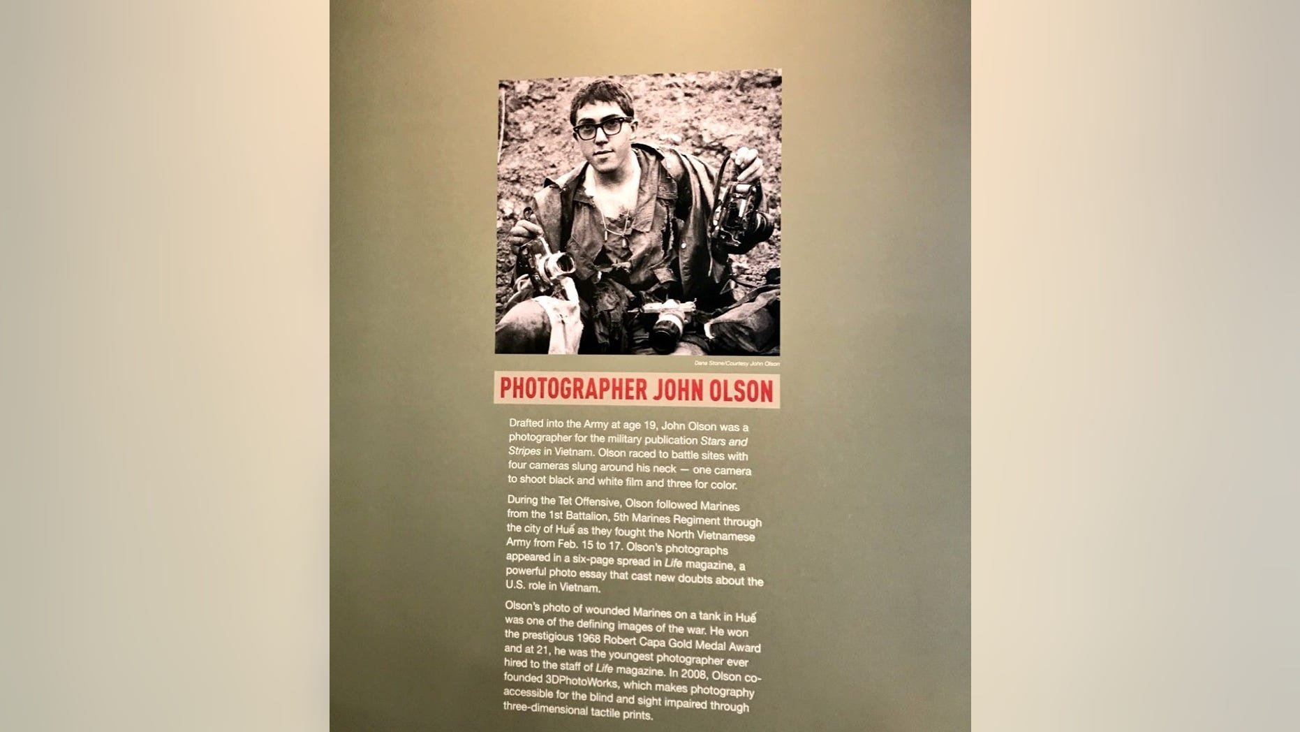 John Olson, a former war photographer, sheds a new light into a defining moment in American history with an exhibit at the Newseum in Washington, D.C.