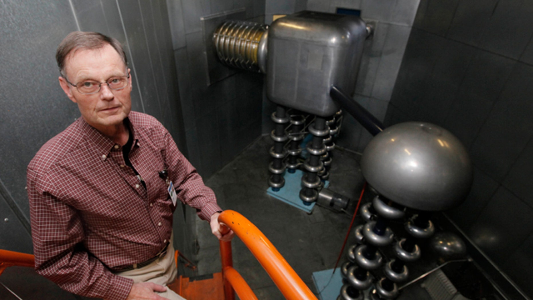Accelerator Division head Roger Dickson, stands in front of a CockcroftWalton generator at the Fermi National Accelerator Laboratory in Batavia, Ill. a week before its scheduled shutdown.