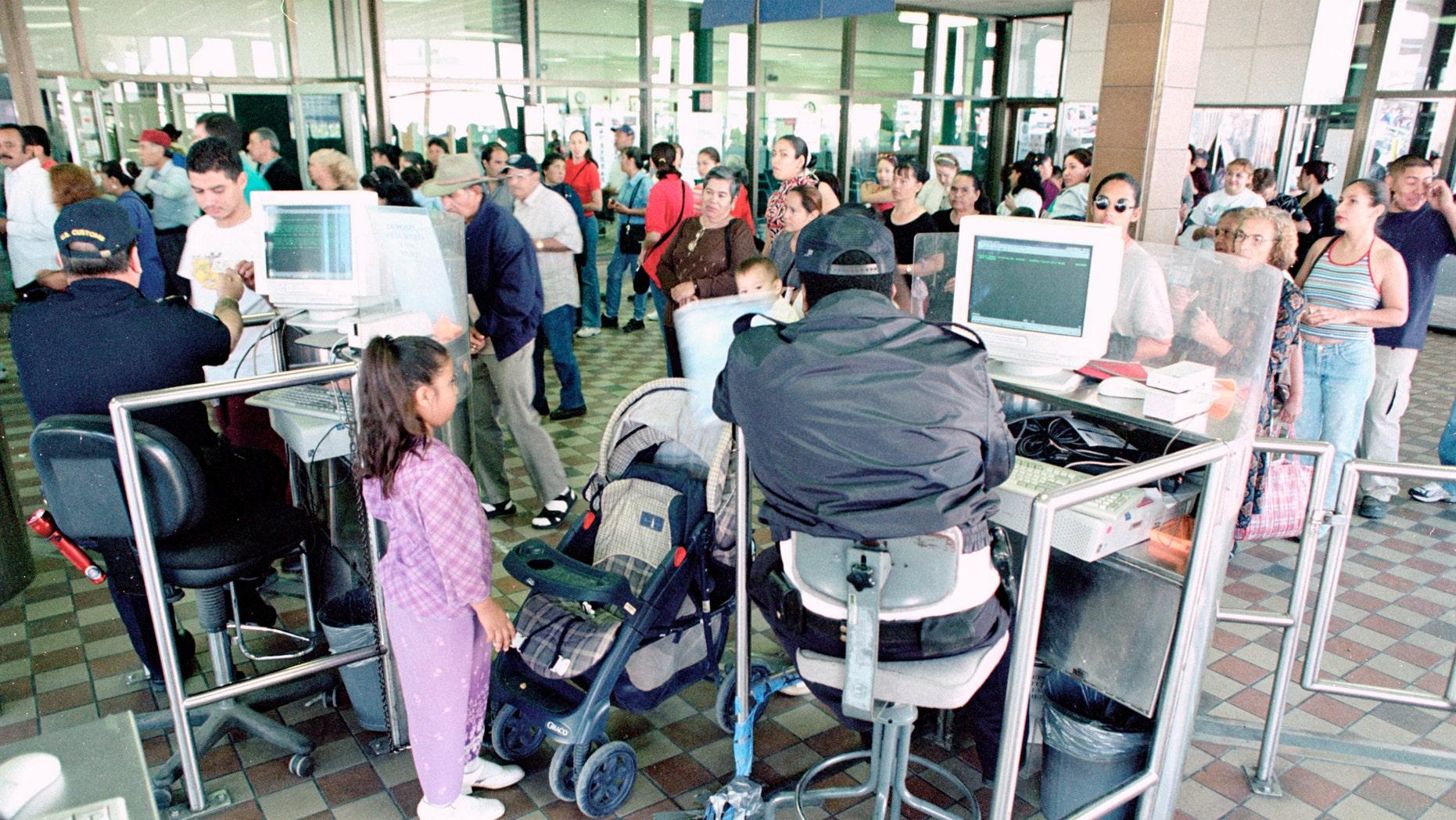 U.S. Customs Inspectors check identity papers at the Paso del Norte port of entry in El Paso, TX.