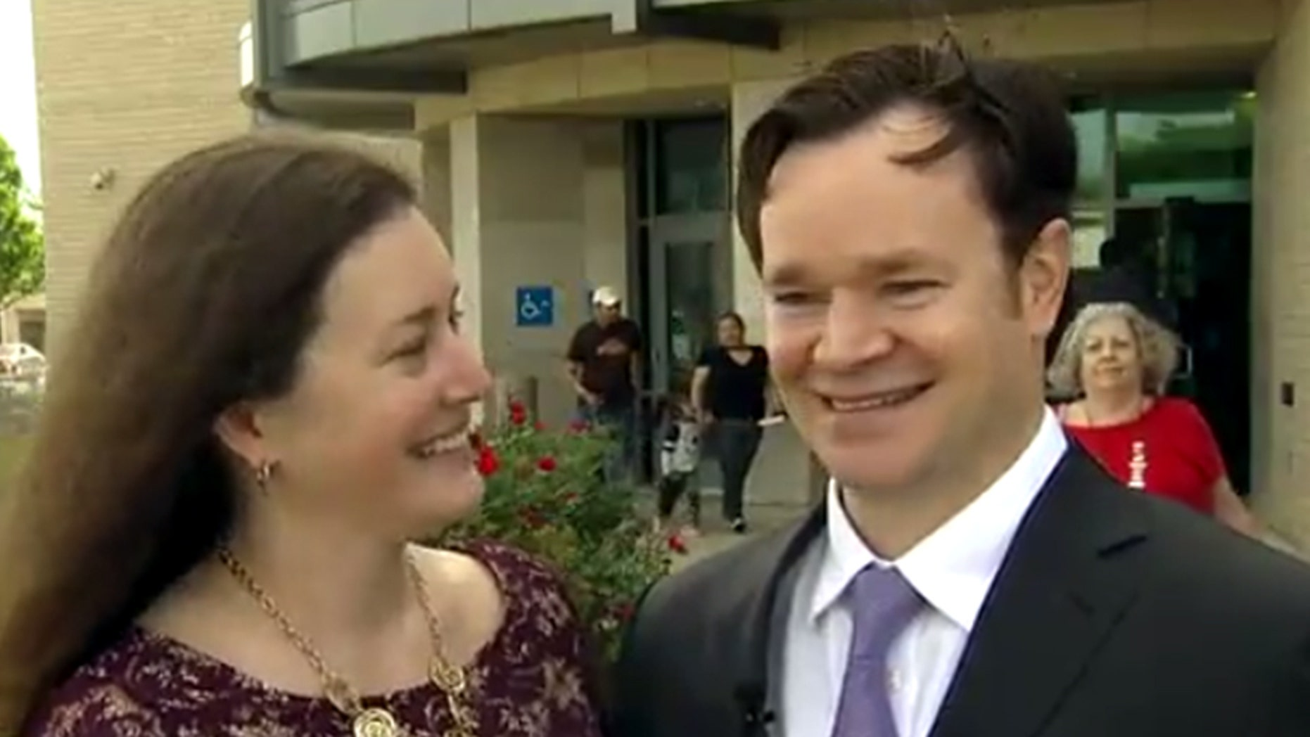 A Texas couple got married outside a sub-courthouse in Arlington after it was evacuated over a suspicious package.