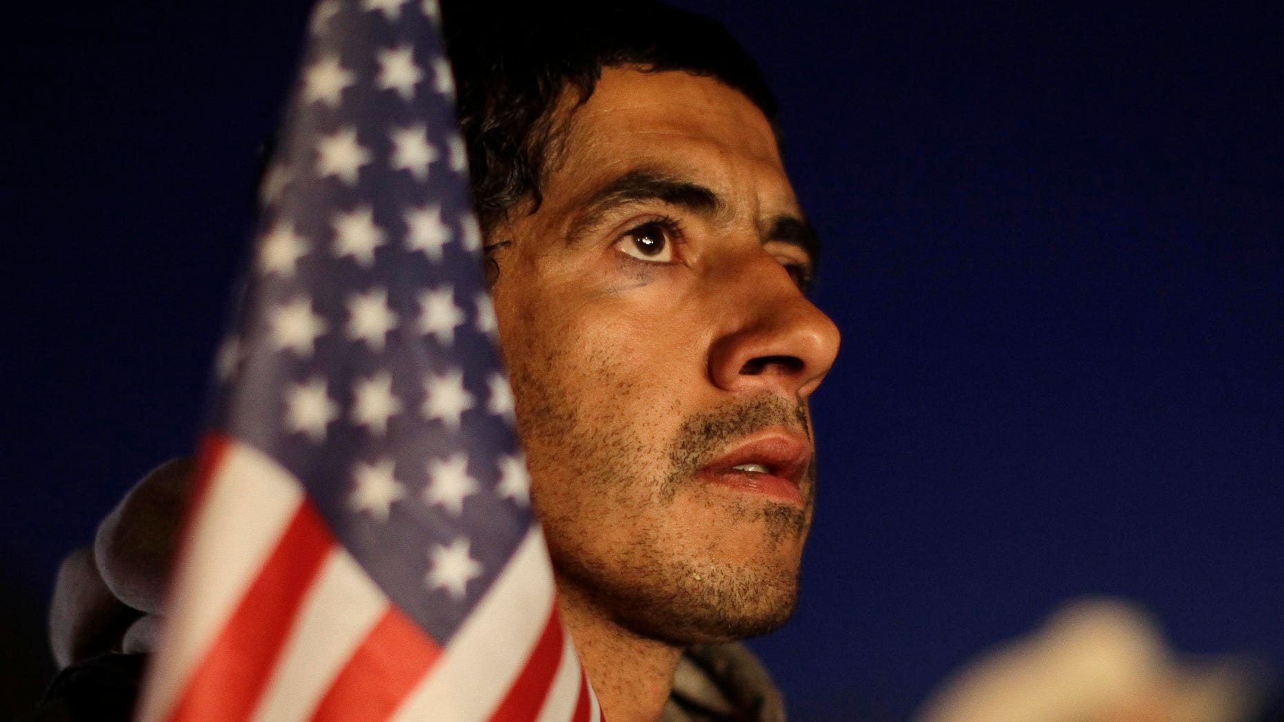Daniel Moreno, of Elko, Nev., listens to speeches during a rally held by the Tea Party Express Monday, Oct. 18, 2010, in Elko, Nev.