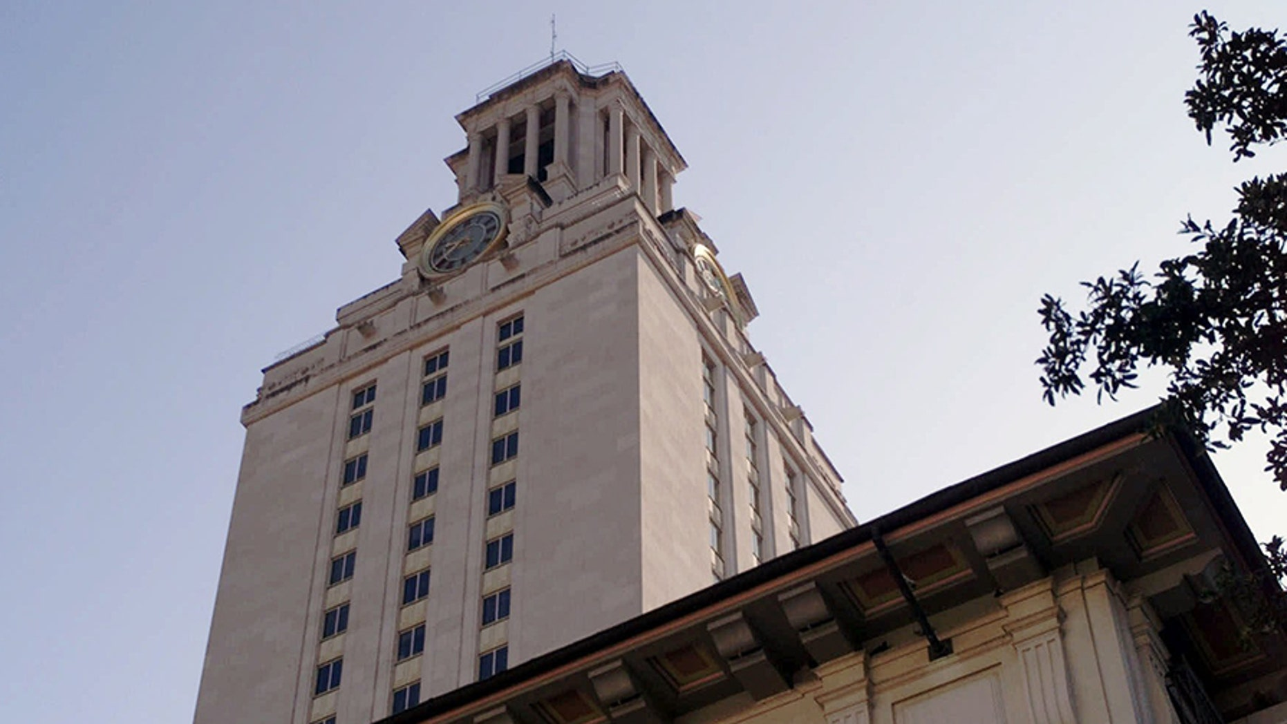 The Main Bell Tower at the University of Texas is shown Wednesday, Sept. 15, 1999, in Austin, Texas. Reopening of the observation deck, located just below the clock face, is a part of the university's 116th birthday celebration. The deck was closed to the public in 1974 after several suicides.  It was the position taken by a sniper in 1966 who killed 14 and wounded 31 people. The protective stainless steel lattice curtain that arches above the deck is a recent addition.  (AP Photo/Harry Cabluck)