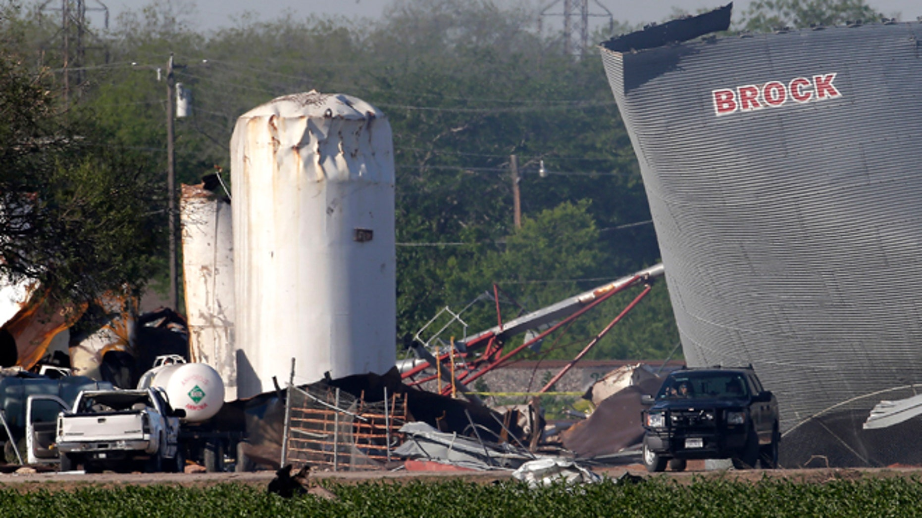 April 20, 2013: Law enforcement personnel patrol the scene three days after an explosion at a fertilizer plant in West, Texas. The massive explosion at the West Fertilizer Co. Wednesday night killed at least 14 people and injured more than 160.
