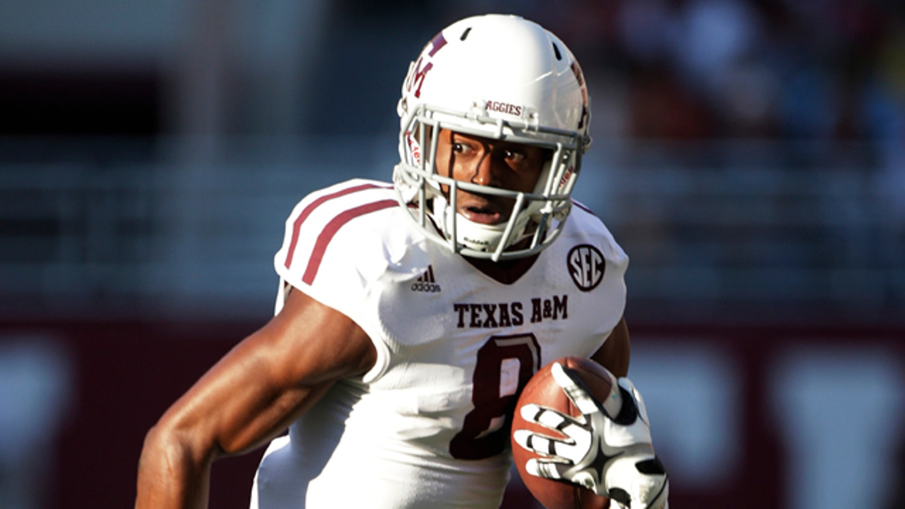 Nov. 10, 2012: In this file photo, Texas A&M wide receiver Thomas Johnson (8) carries for extra yardage after a reception during an NCAA college football game in Tuscaloosa, Ala.