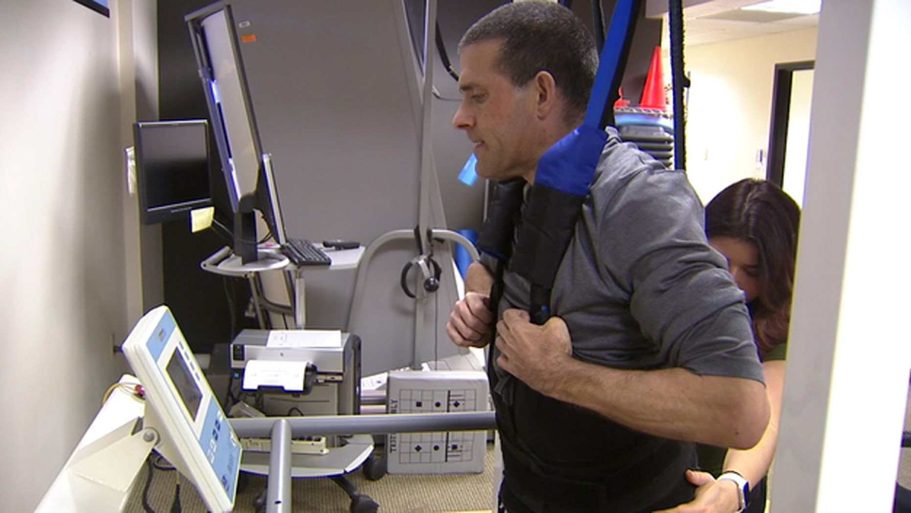 Det. Daniel Bardwell, left paralyzed from the chest down by a complication from a long-term illness, is fighting hard to get back to work.