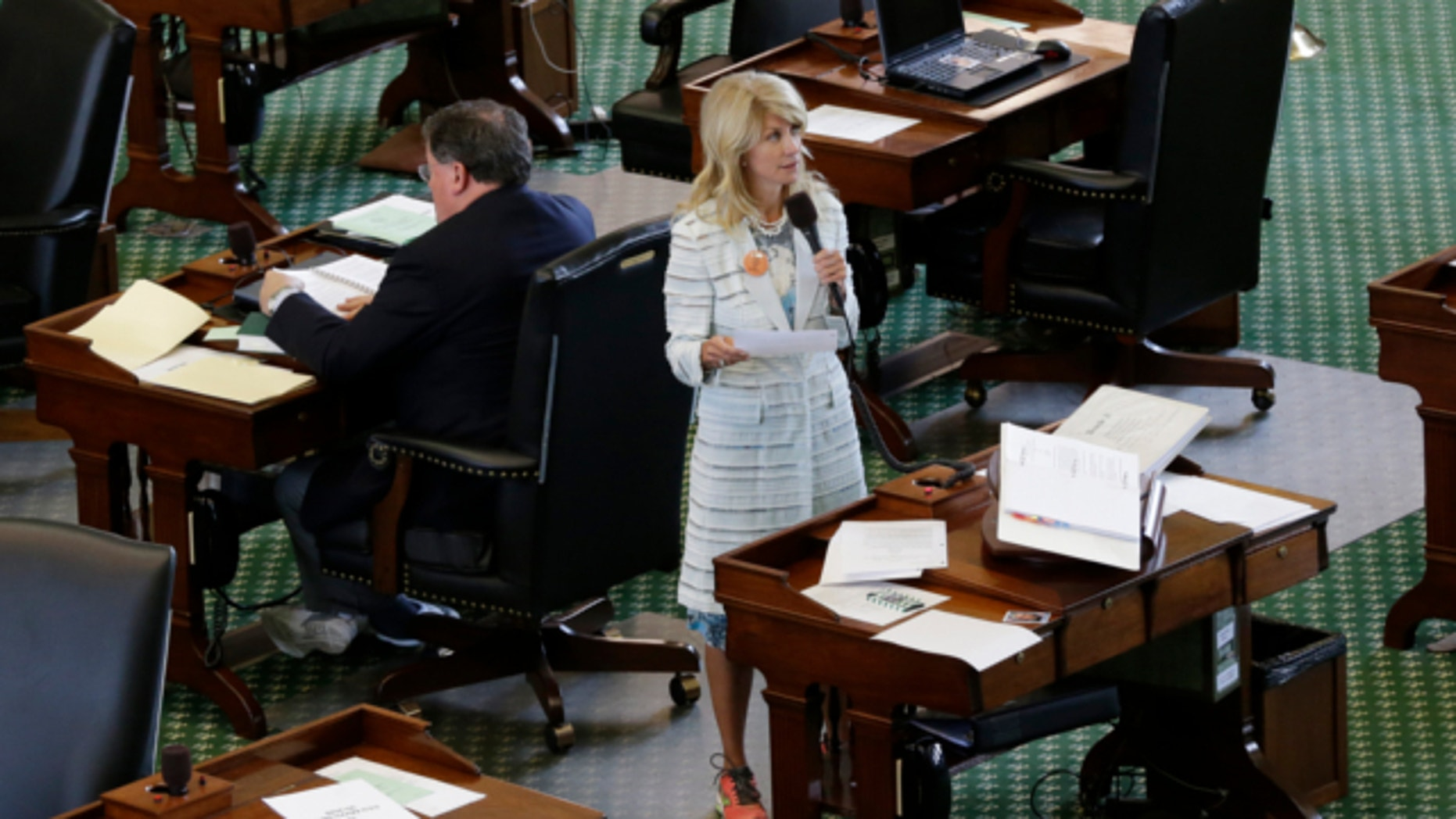 June 25, 2013: Sen. Wendy Davis, D-Fort Worth, stands on a near empty senate floor as she filibusters in an effort to kill an abortion bill in Austin, Texas.