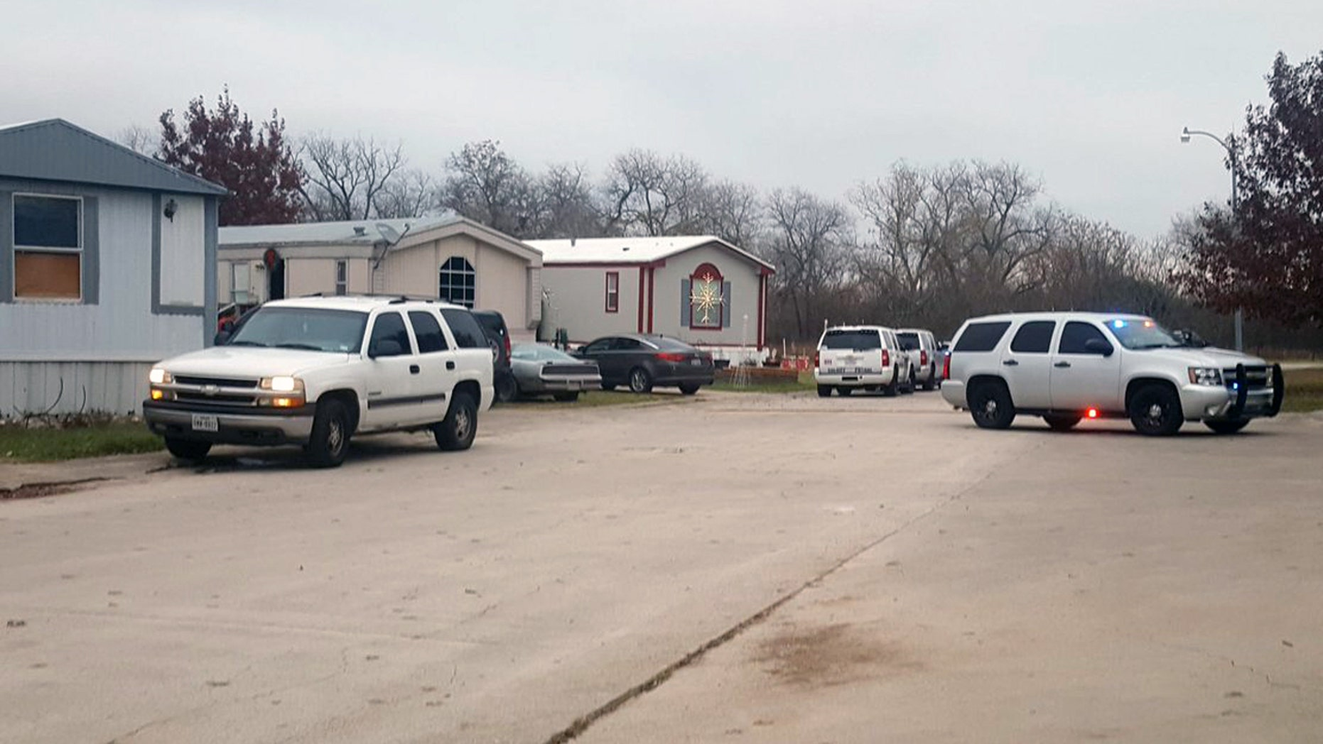 Authorities respond to a mobile home park in Schertz, Texas where a female suspect and a 7-year-old boy were killed in a gun battle.
