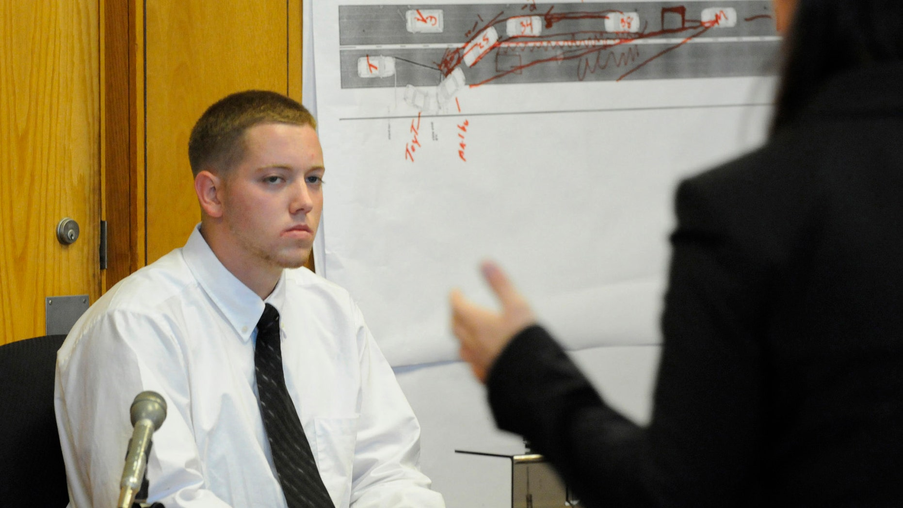 June 5, 2012: Defendant Aaron Deveau, 18, listens to assistant district attorney Ashlee Logan while testifying at Haverhill District Court in Haverhill, Mass.