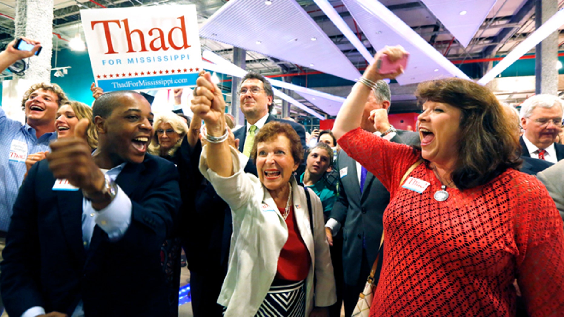 June 24, 2014: Supporters of Sen. Thad Cochran, R-Miss., break into cheer as he is declared the winner in his primary runoff for the GOP nomination for U.S. Senate at his victory party at the Mississippi Children's Museum in Jackson, Miss.
