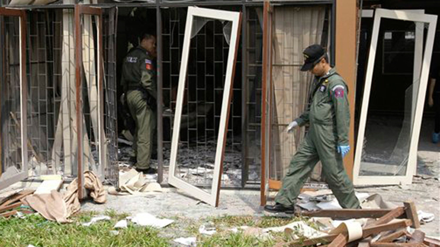 Feb. 15, 2012: Thai Explosive Ordnance Disposal (EOD) officials examine the damage caused by a blast at the house where suspected bomber Saeid Moradi was staying in Bangkok, Thailand.