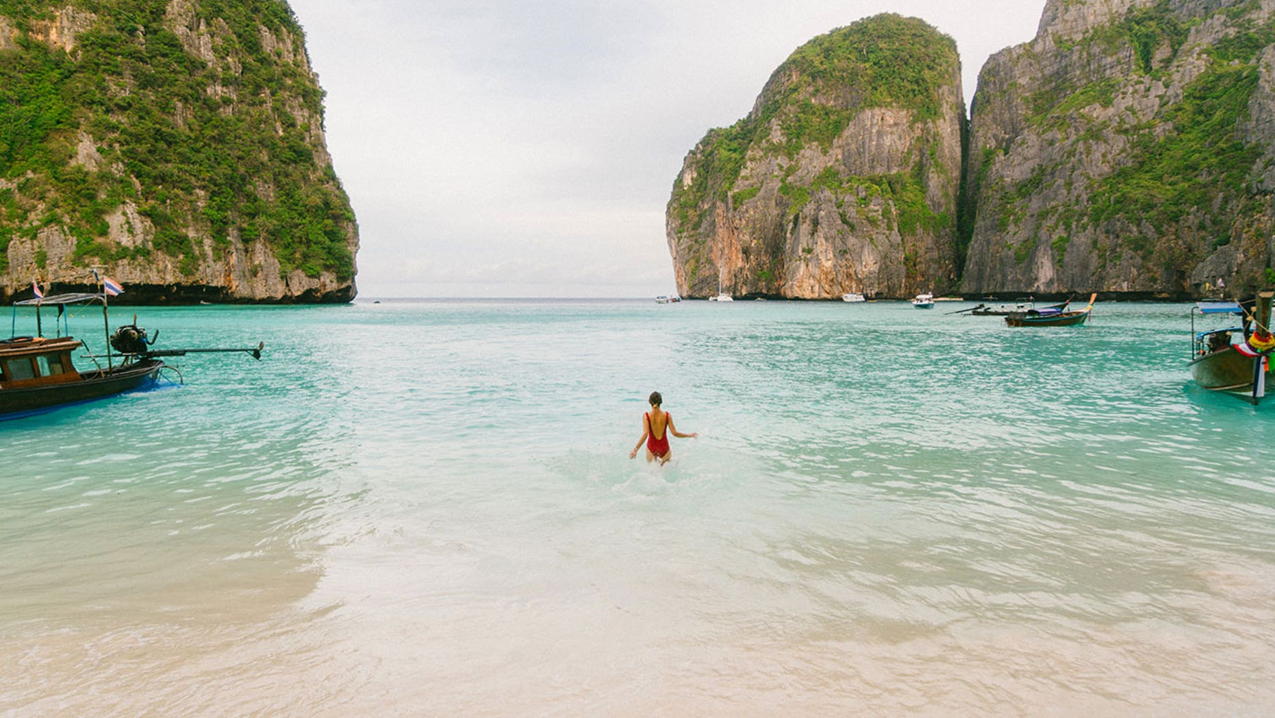 """The Phi Phi islands have been popular with tourists since they were featured in Danny Boyle's 2000 film """"The Beach,"""" but authorities say visitors are contributing to the damage of the coral reefs."""