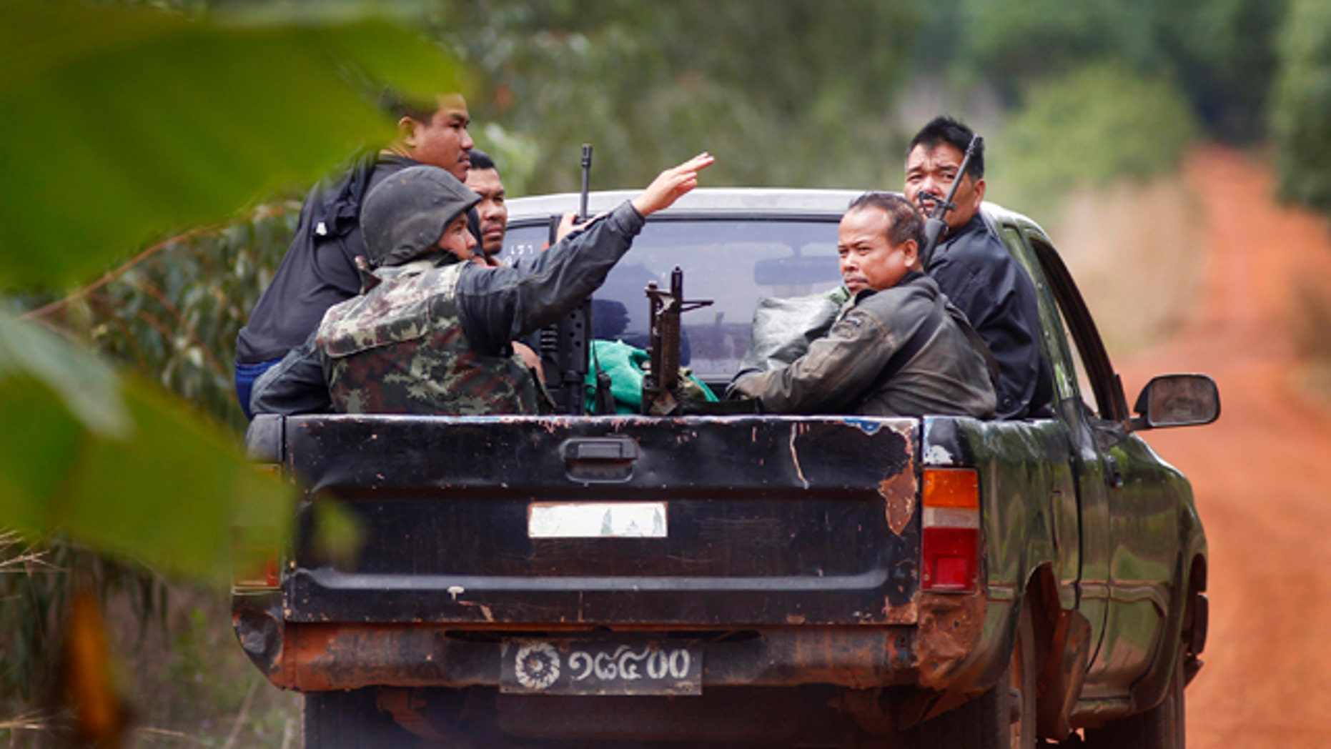 April 29: Thai soldiers ride a pickup during clashes between Thai and Cambodian soldiers in Surin province, northeastern Thailand, Friday, April 29, 2011. A brief cease-fire between the two countries broke down Friday, shattering hopes for a quick end to the border conflict as the two sides exchanged fire for an eighth day. (AP)