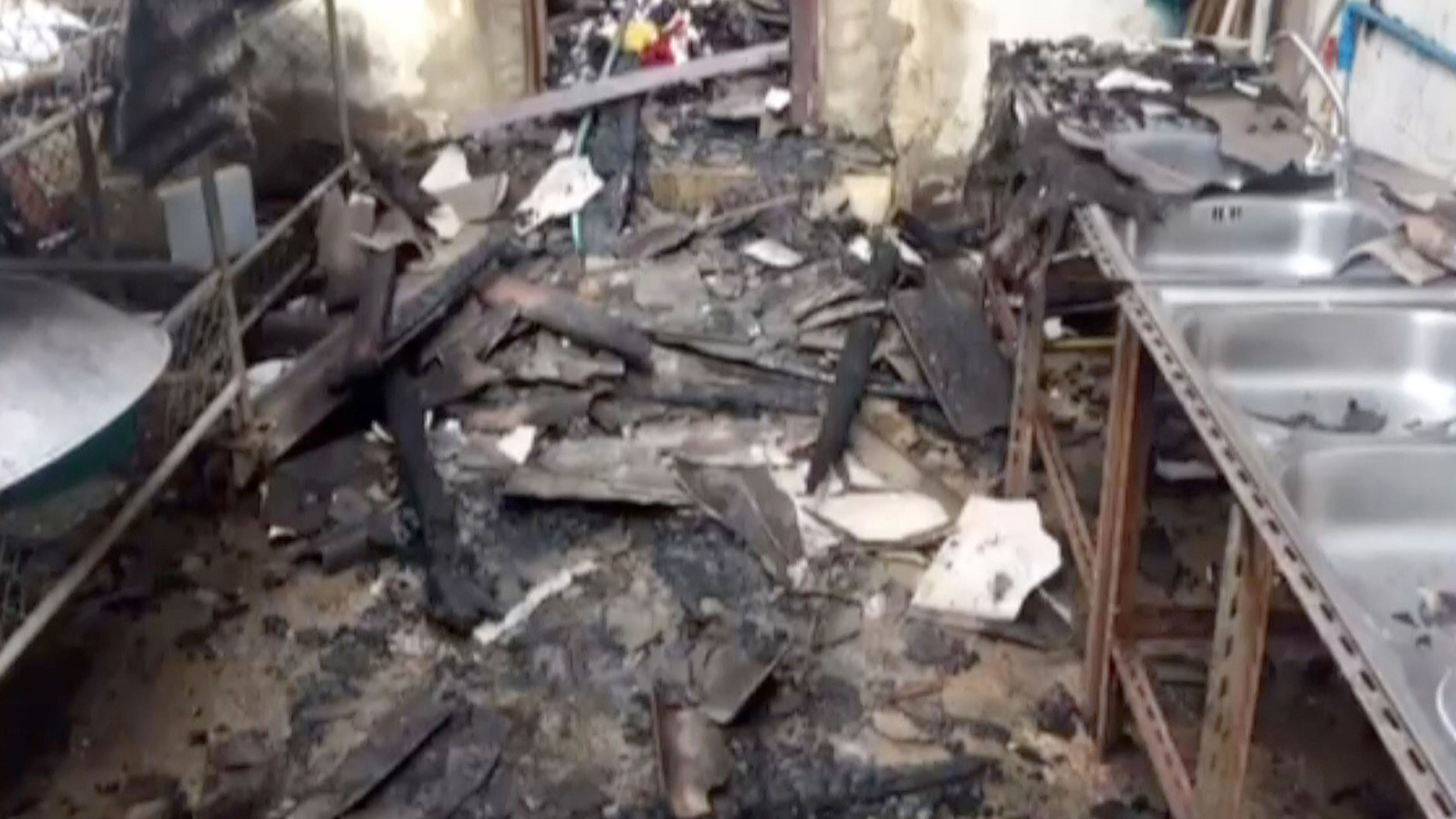 May 23, 2016: This image made from video shows the inside of a damaged school dormitory where local police say 18 girls, ranging from 5 to 12 years old, died in a fire in Chiang Rai province, northern Thailand.