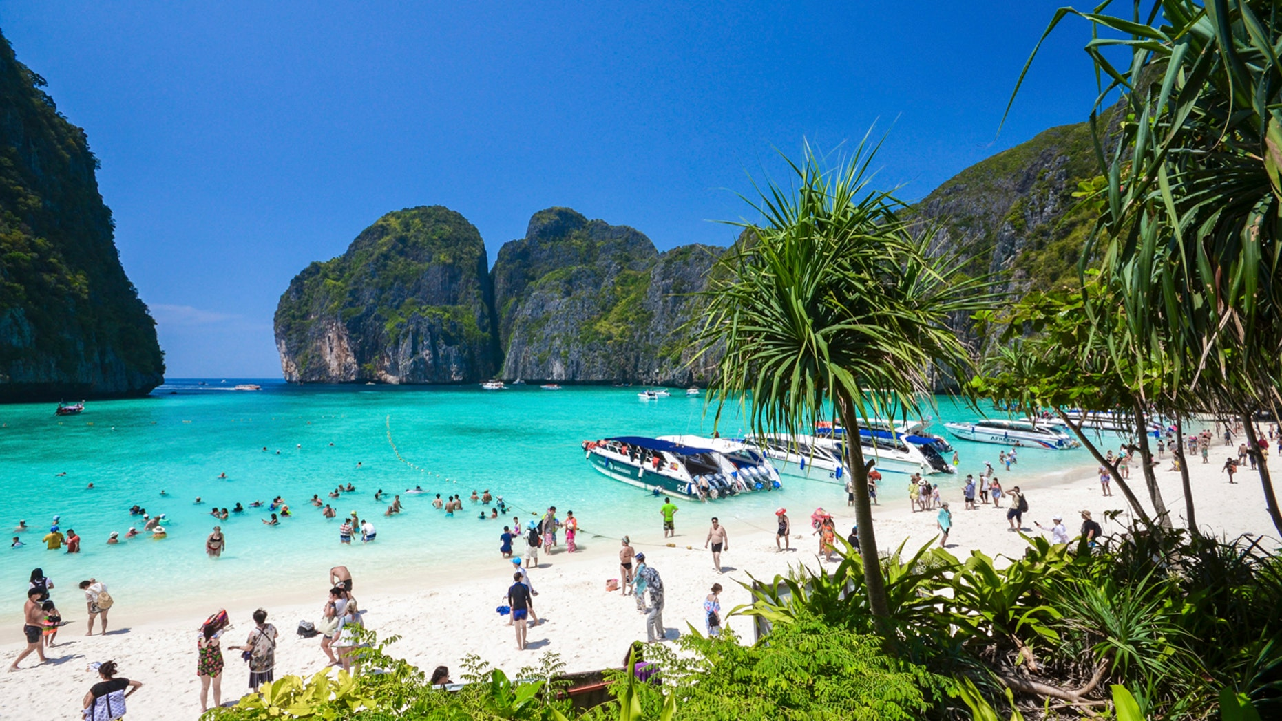 "In this March 4, 2017, photo, tourists enjoy the popular Maya bay on Phi Phi island, Krabi province. Authorities have ordered the temporary closing of the beach made famous by the Leonardo DiCaprio movie ""The Beach"" to halt environmental damage caused by too many tourists."