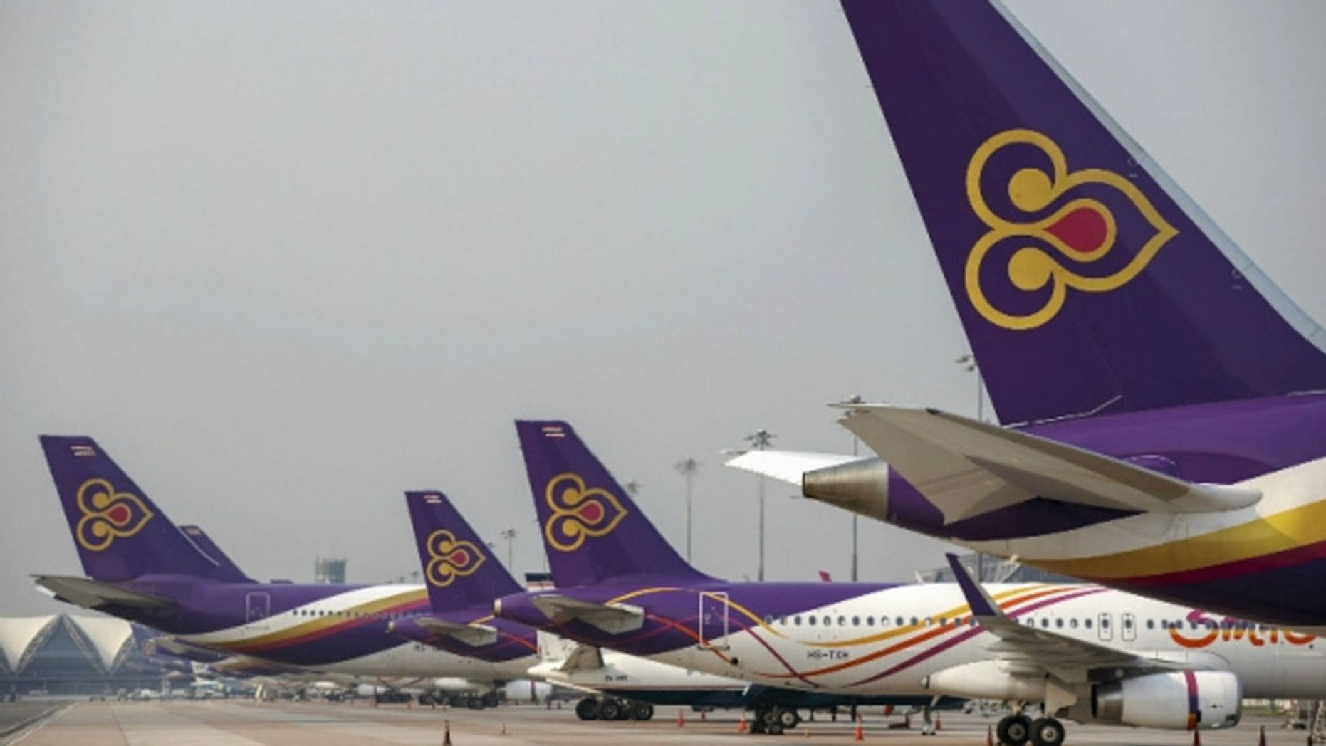 The low-cost Thai Smile Airlines, a subsidiary of Thai Airways, is selling child-seat tickets for Look Thep dolls.