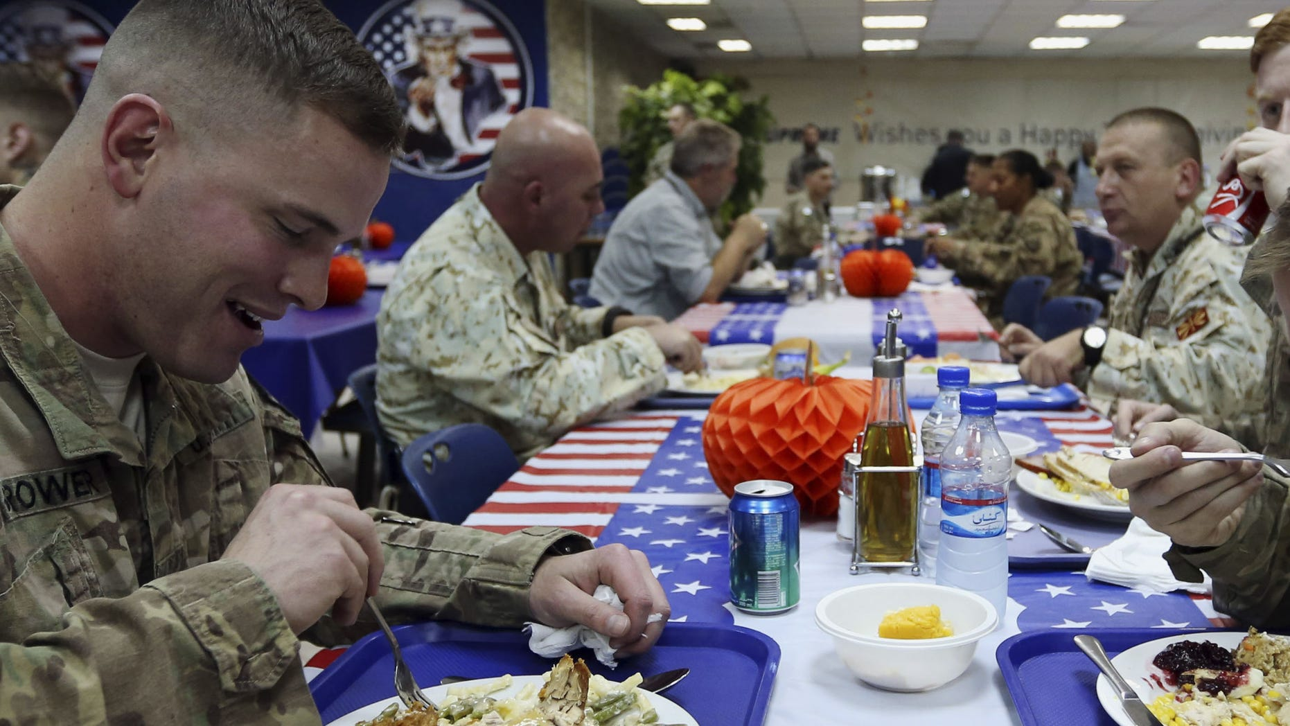 NATO soldiers have their Thanksgiving Day meals at the ISAF headquarters in Kabul, Afghanistan, Thursday, Nov. 27, 2014. This is the last Thanksgiving cerebration before the U.S. and NATO combat mission ends on Dec. 31 this year. (AP Photo/Rahmat Gul)