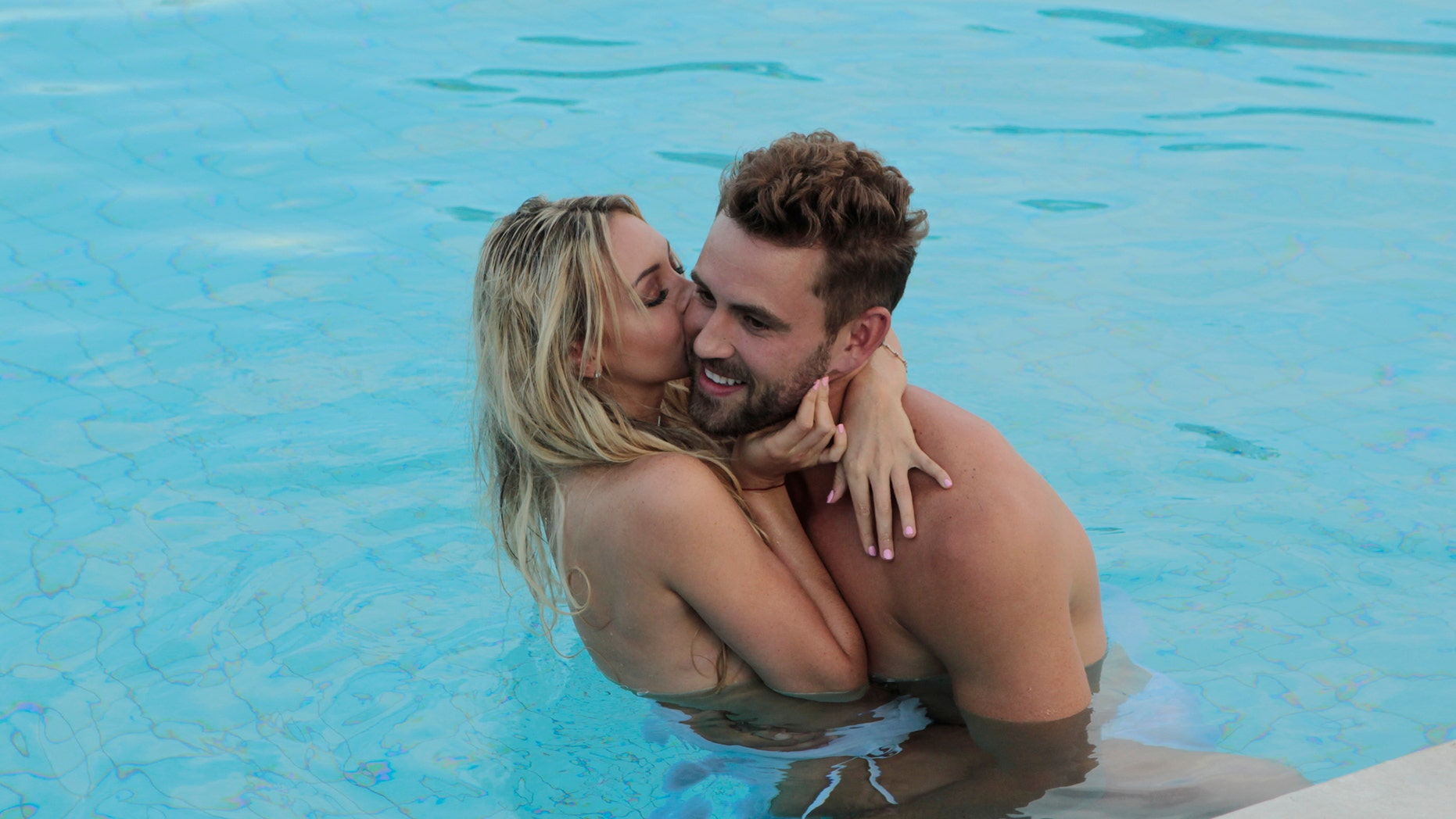 """Corrine embraces Nick in the pool on """"The Bachelor."""""""