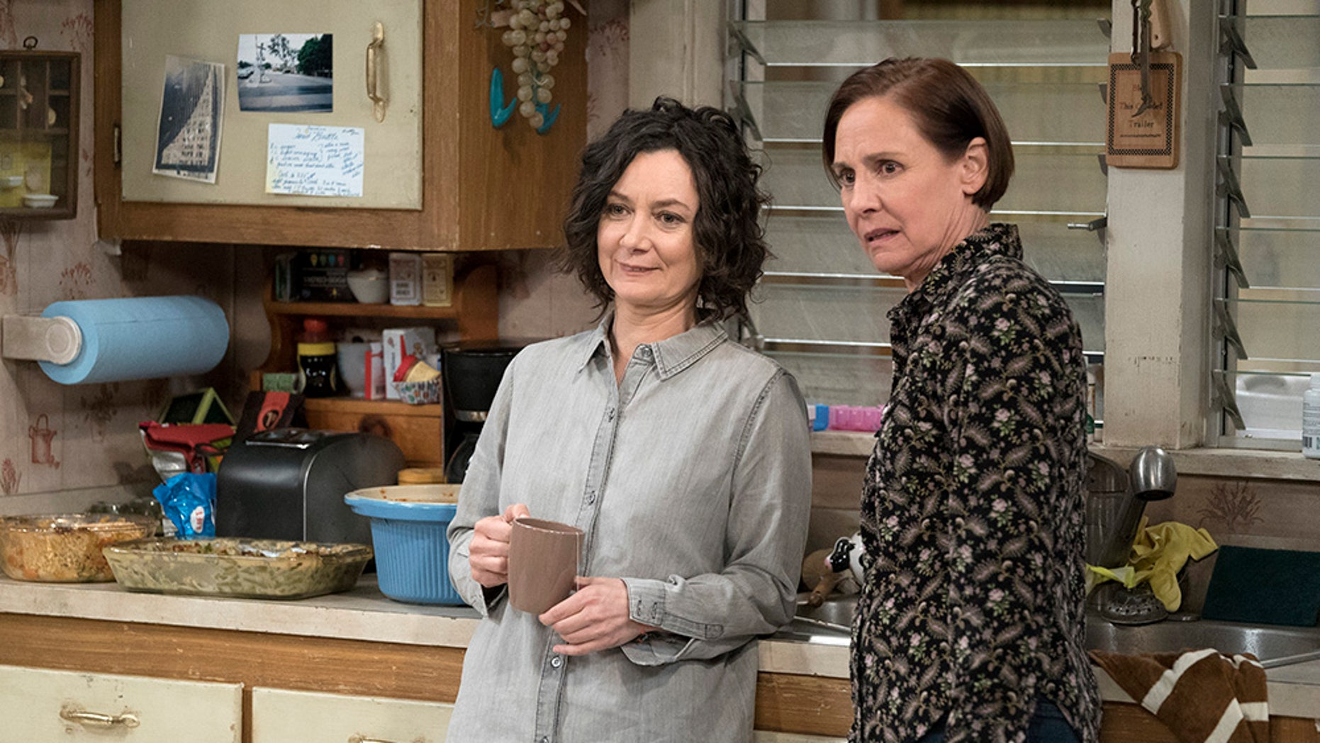 "Sara Gilbert and Laurie Metcalf appear in ""The Conners"" premiere episode, ""Keep on Truckin."" According to ABC, in the Oct. 16 episode, a sudden turn of events forces the Conners to face the daily struggles of life in Lanford in a way they never have before."