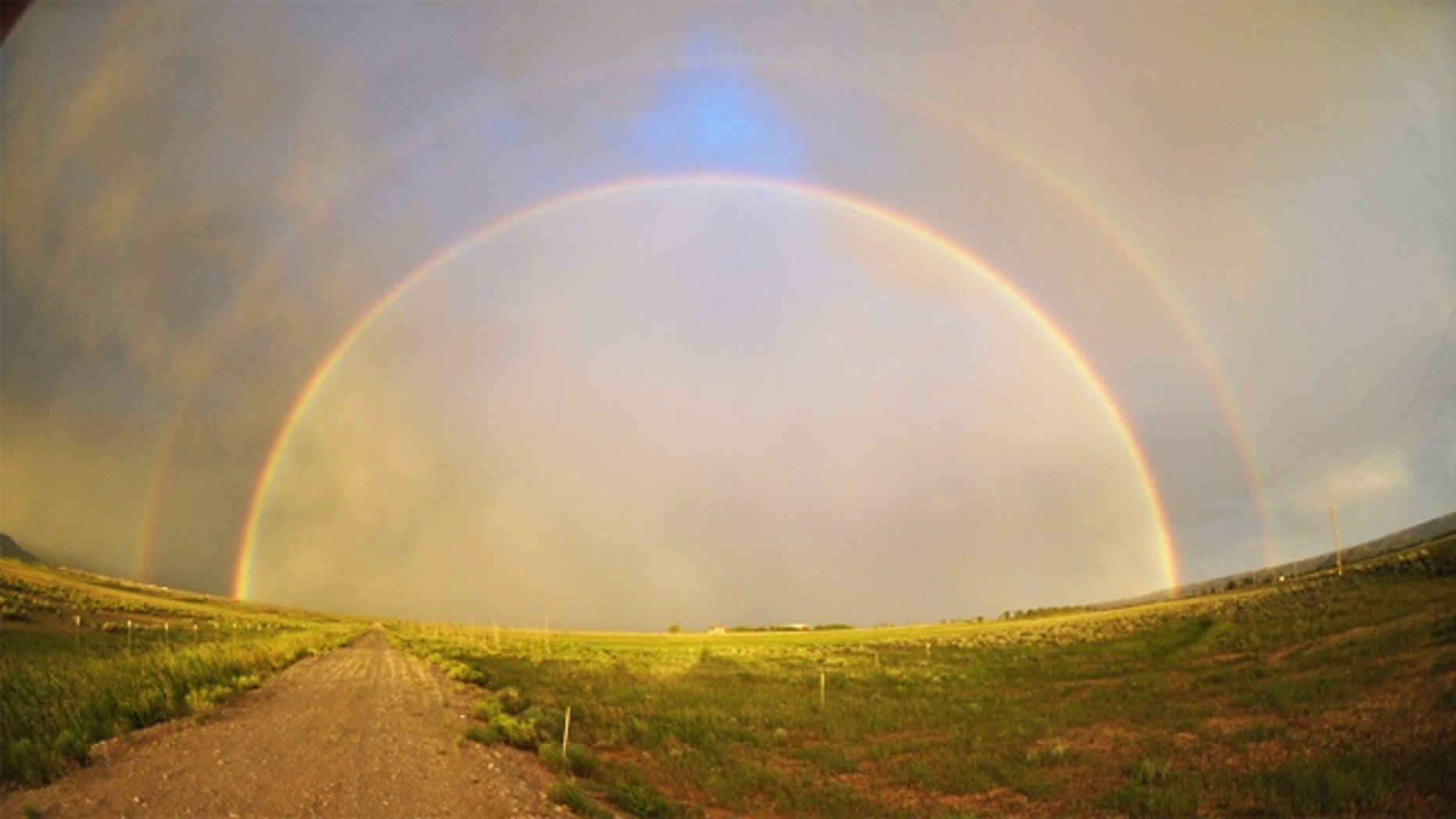 While on vacation on July 18, Texas native Jonathan Boening took this photograph of a double rainbow on a drive to Yellowstone National Park.