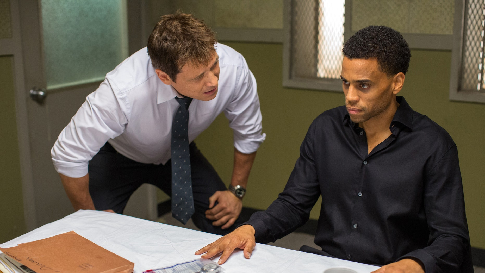 """Holt McCallany, left, as Detective Hansen, interogates Michael Ealy as Carter in """"The Perfect Guy."""""""