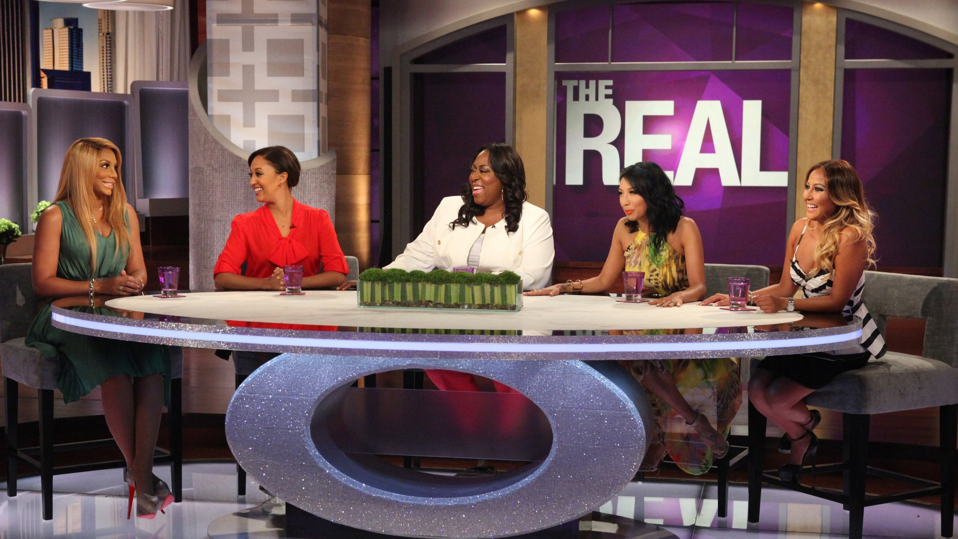 """Hosts of """"The Real"""" (From Left to Right: Tamar Braxton, Tamera Mowry-Housley, Loni Love, Jeannie Mai and Adrienne Bailon) on set."""