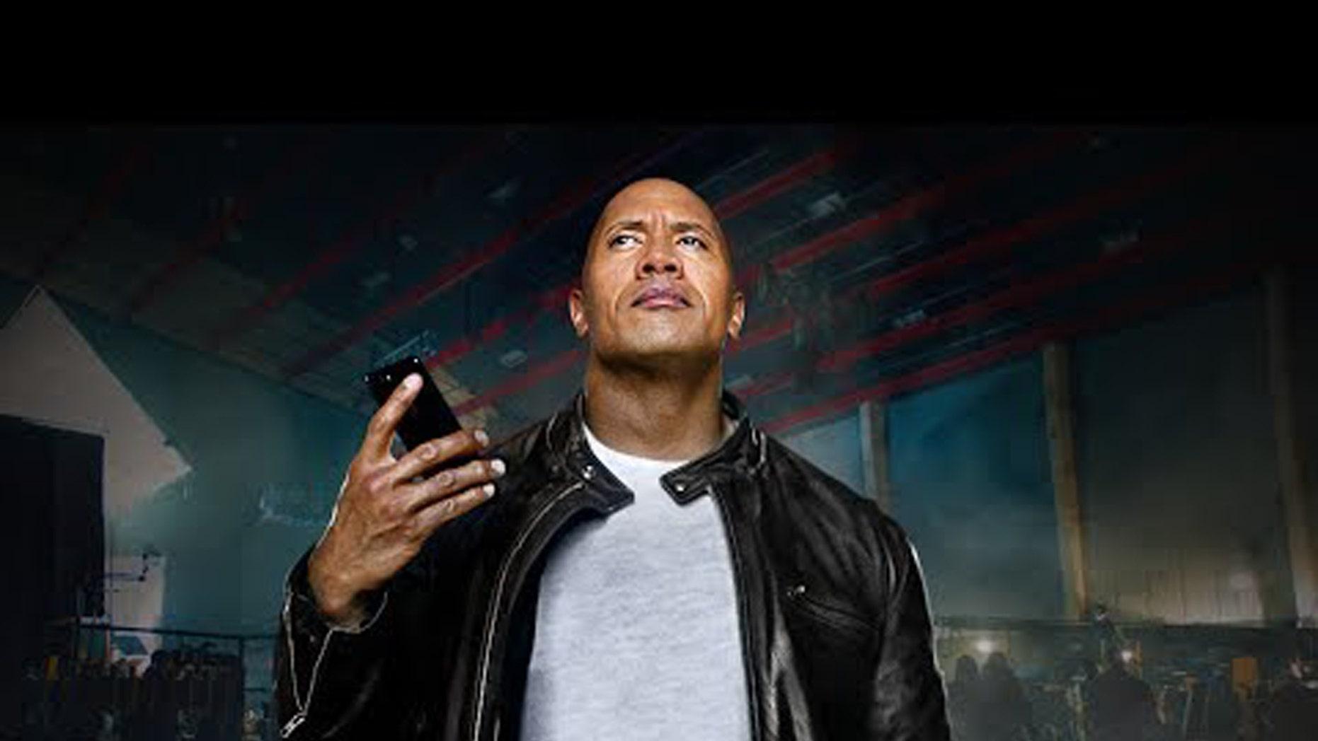 Dwayne Johnson holding an iPhone 7. (Credit: Apple, YouTube)