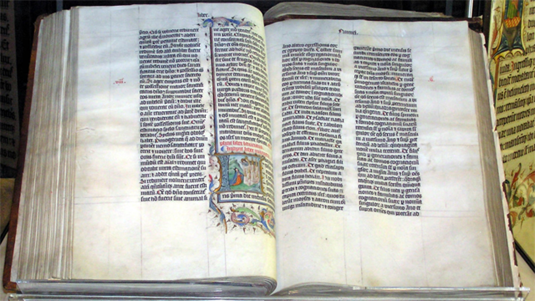 A Bible handwritten in Latin, on display in Malmesbury Abbey, Wiltshire, England.