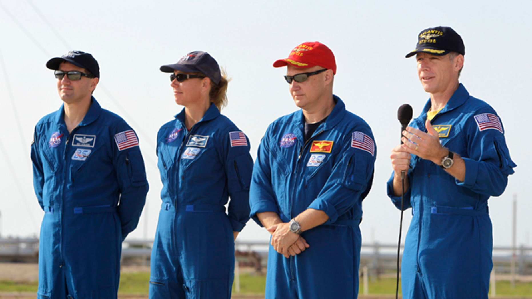 The crew of space shuttle Atlantis, from left, mission specialist Rex Walhiem, mission specialist Sandy Magnus, pilot Doug Hurley and commander Chris Ferguson attend a news conference at Pad 39A during the Terminal Countdown Demonstration Test at the Kennedy Space Center in Cape Canaveral, Fla., Wednesday, June 22, 2011.