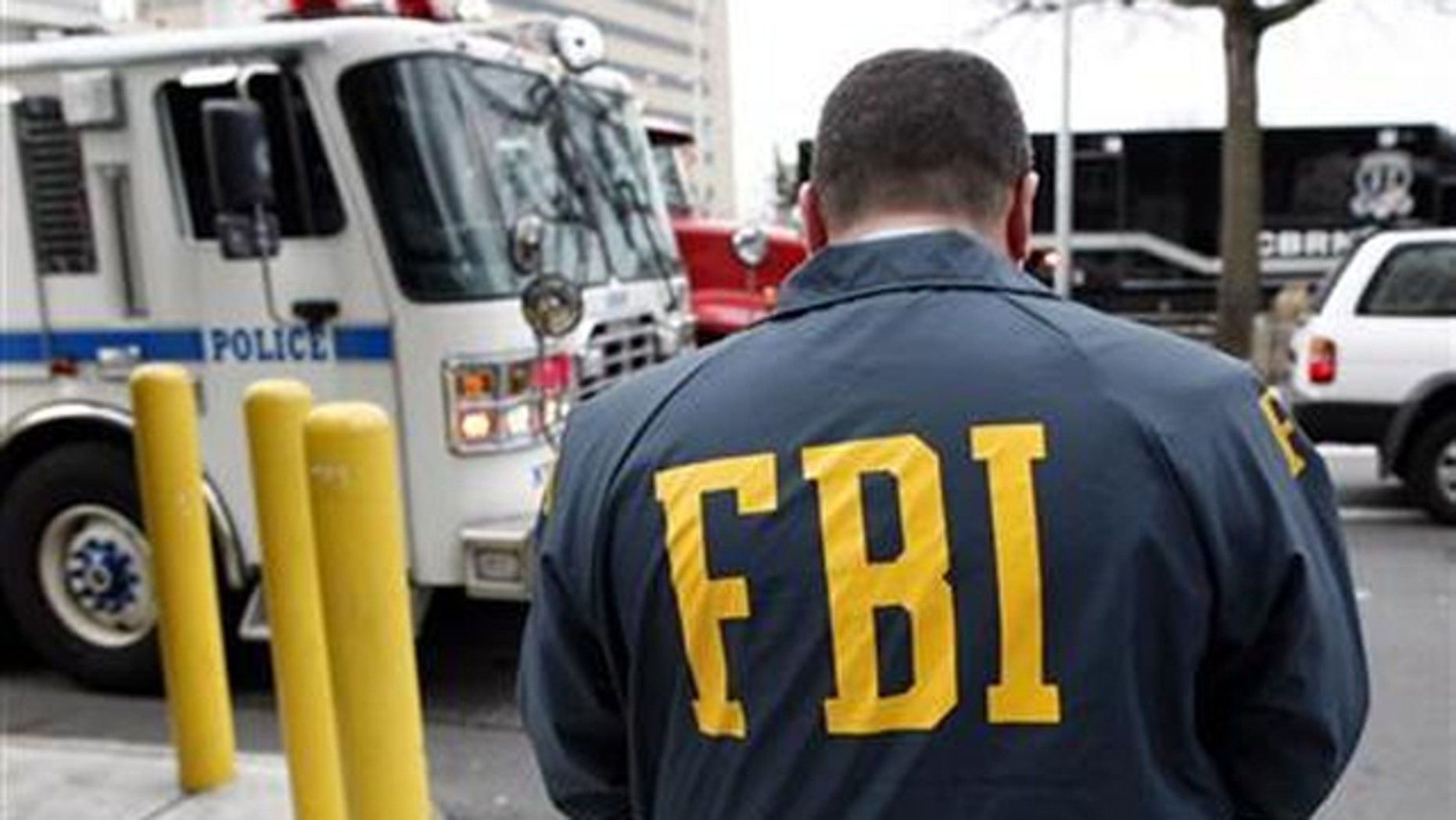 The FBI has seized almost 50 computers of suspects involved in a scheme that scammed a million victims.