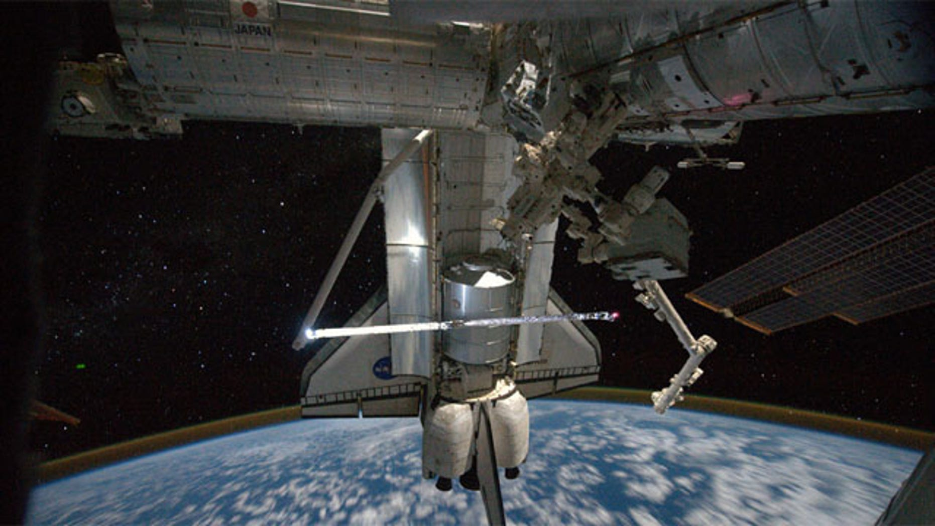 This view of the space shuttle Atlantis while still docked with the International Space Station was taken by a crew member aboard the station on the final day of joint activities between the crew members for the STS-135 and Expedition 28 missions.