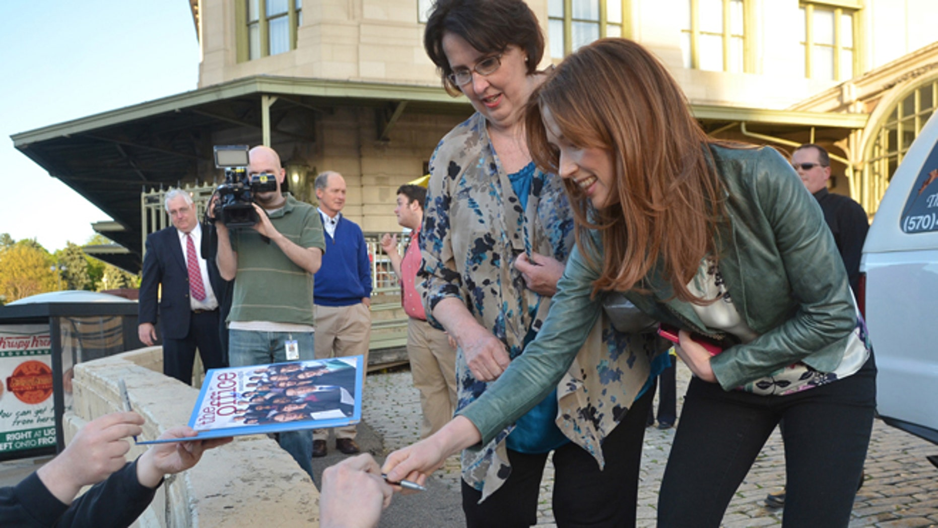 "May 3, 2013: The ""Office"" actors, Phyllis Smith and Ellie Kemper, sign autographs outside the Radisson Lackawanna Station Hotel in Scranton, Pa."