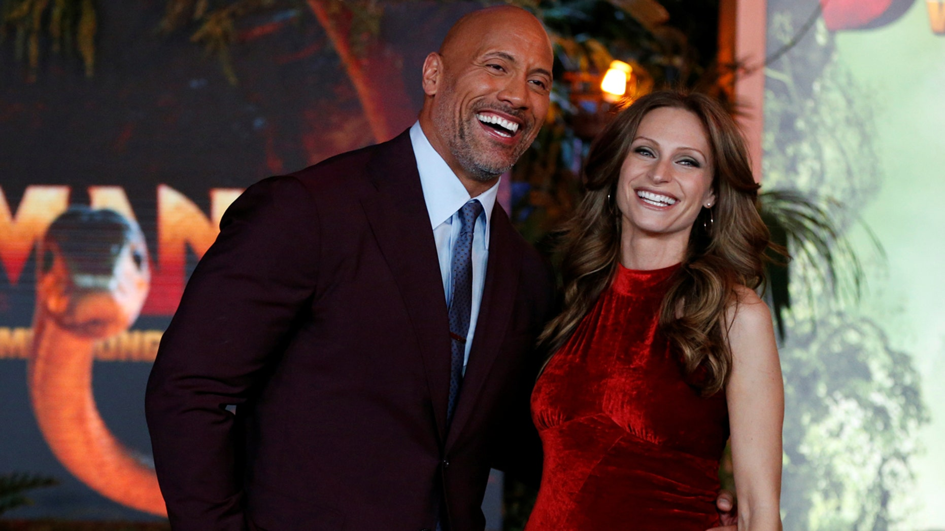 """Cast member Dwayne Johnson and Lauren Hashian pose at the premiere for """"Jumanji: Welcome to the Jungle"""" in Los Angeles, California, U.S., December 11, 2017. REUTERS/Mario Anzuoni - RC1DCC32B840"""