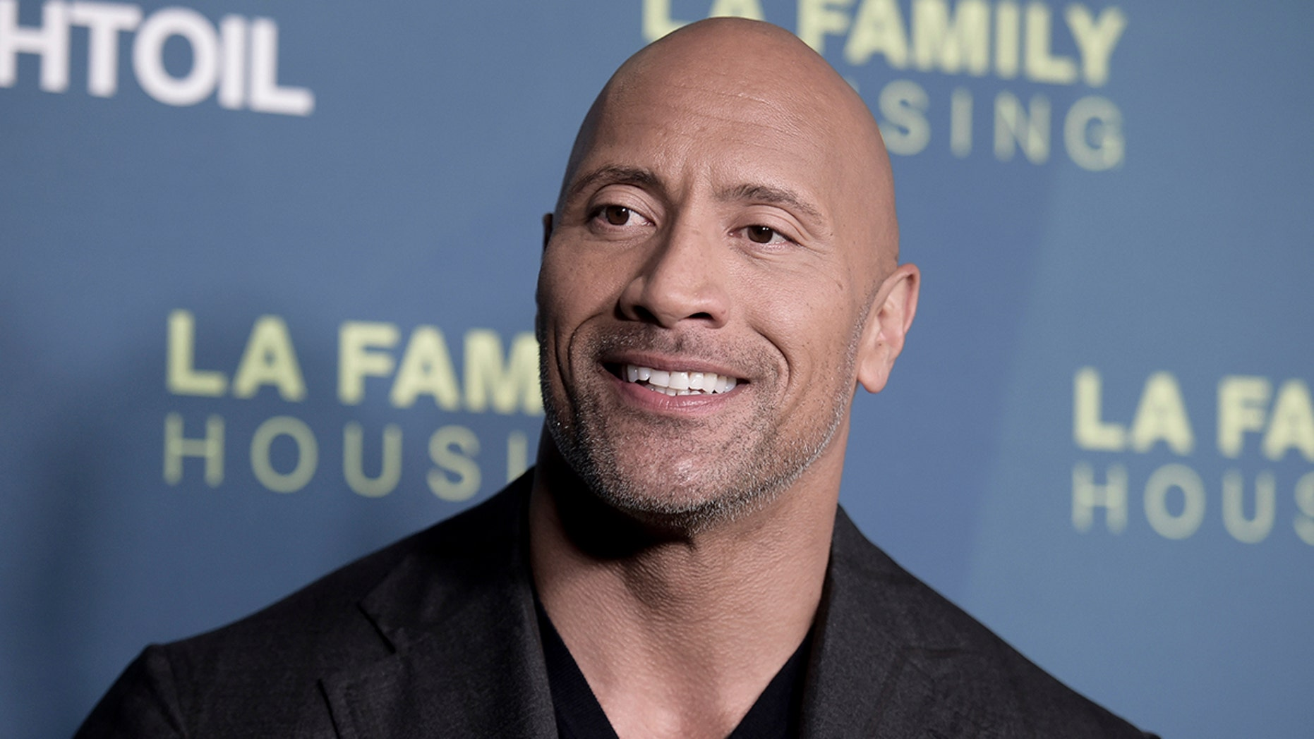 Dwayne Johnson attends the 2018 LA Family Housing Awards at The Lot Studios on Thursday, April 5, 2018, in West Hollywood, Calif. (Photo by Richard Shotwell/Invision/AP)