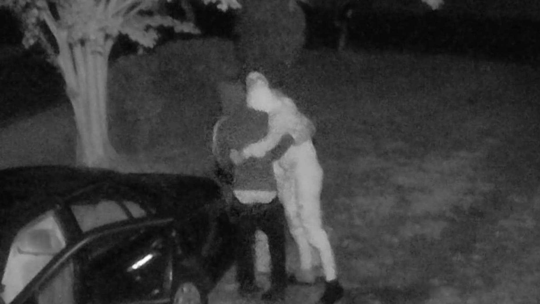 Three men in Virginia were caught hugging and jumping for joy after reportedly stealing hundreds of dollars from an unlocked car early Tuesday morning.