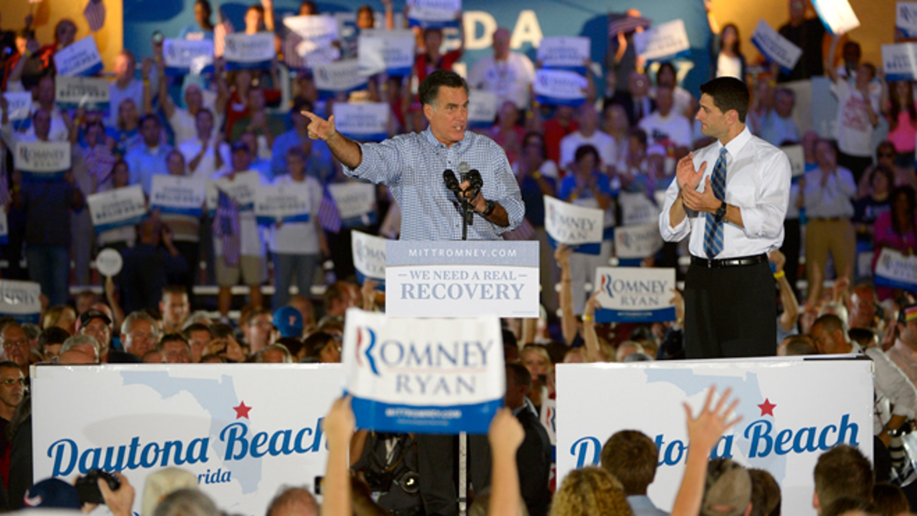 Oct. 19, 2012: Republican presidential candidate, former Massachusetts Gov. Mitt Romney, left, addresses supporters as his vice presidential running mate Rep. Paul Ryan, R-Wis., listens at the Daytona Beach Historic Bandshell during the Romney Ryan Victory Rally in Daytona Beach, Fla.