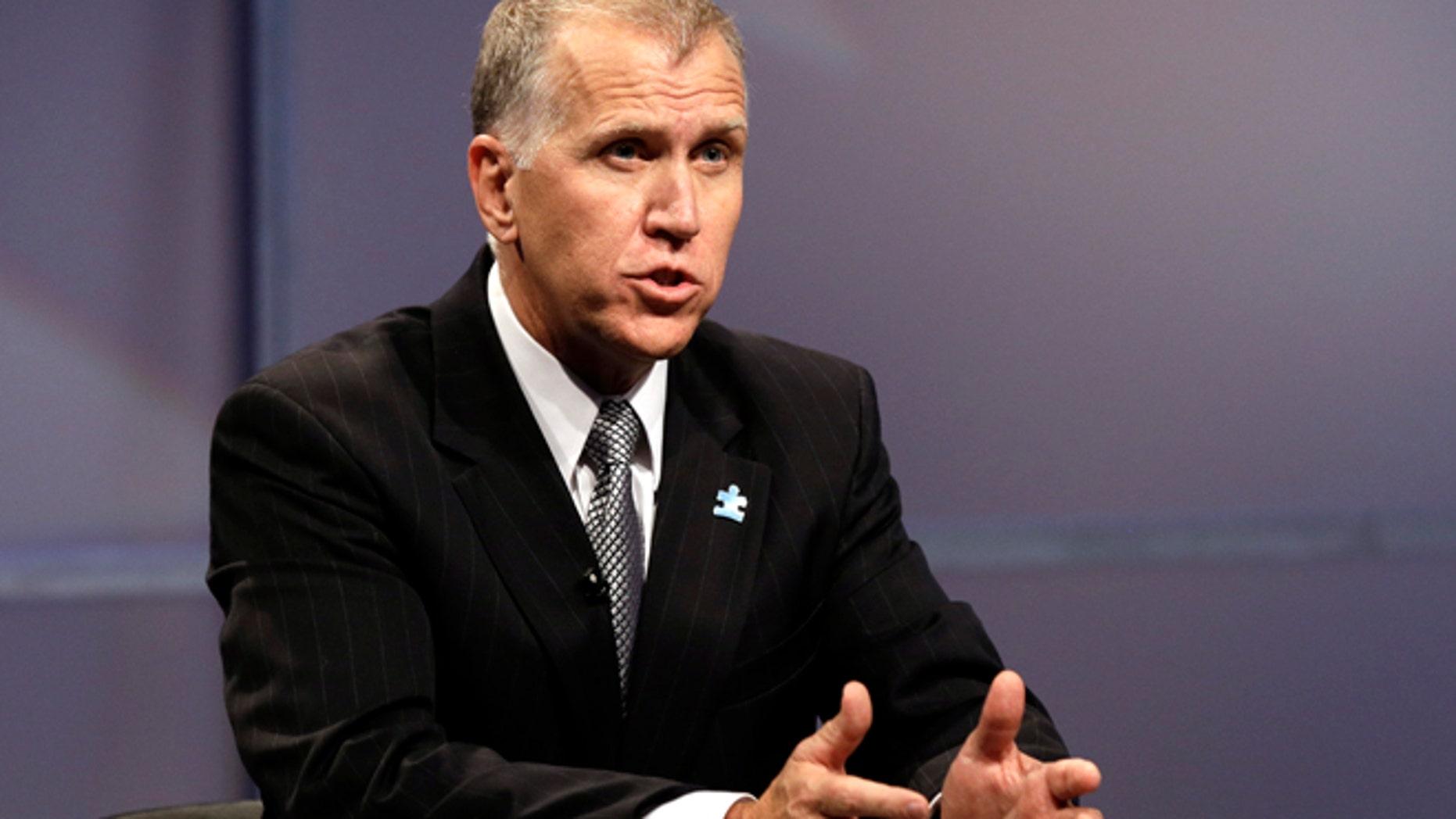 April 23, 2014: Republican senatorial candidate Thom Tillis responds during a televised debate at WRAL television studios in Raleigh, N.C.