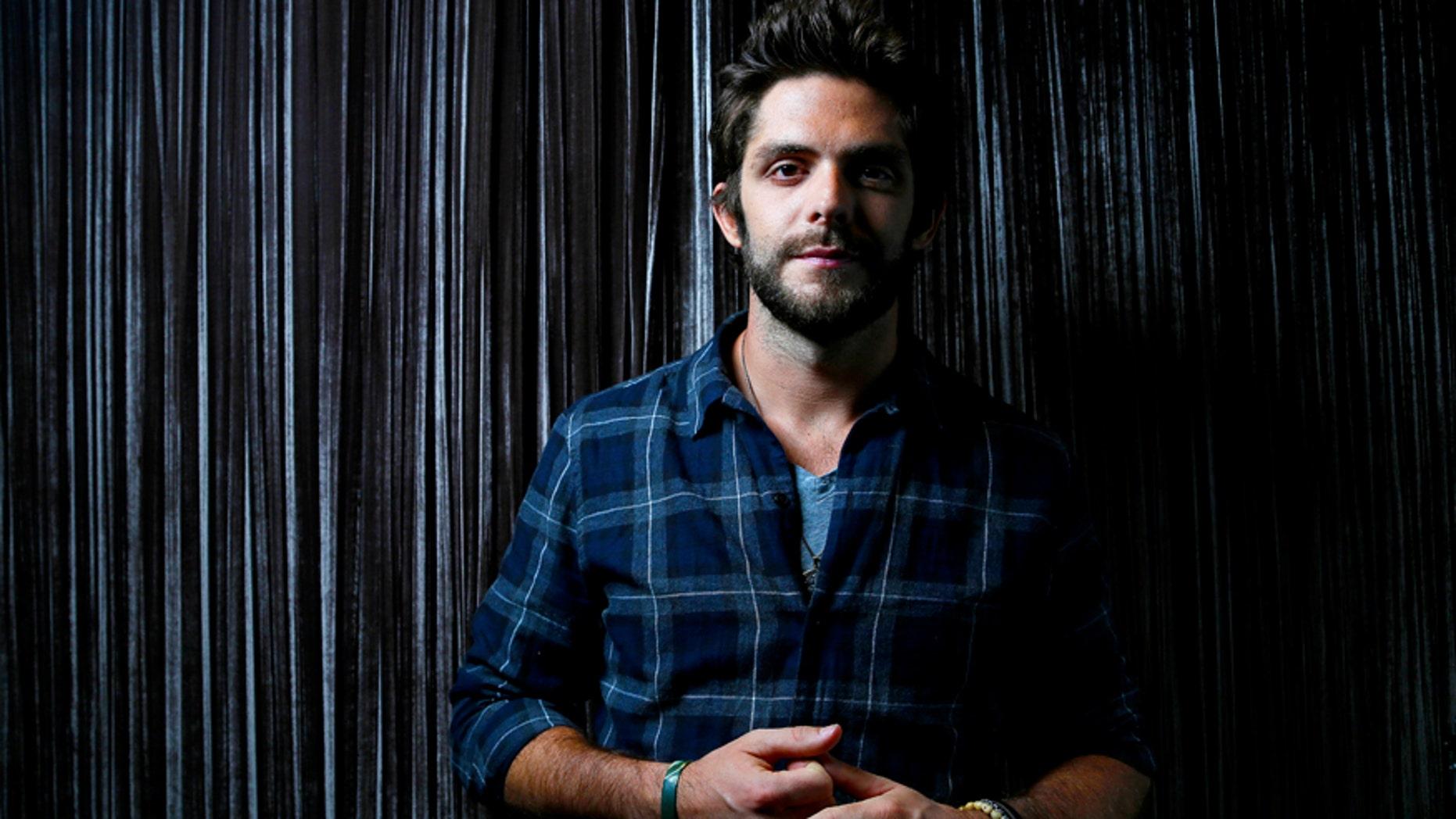 In this Sept. 15, 2015 file photo, country singer Thomas Rhett poses for a photo at Sinema Restaurant & Bar in Nashville, Tenn.