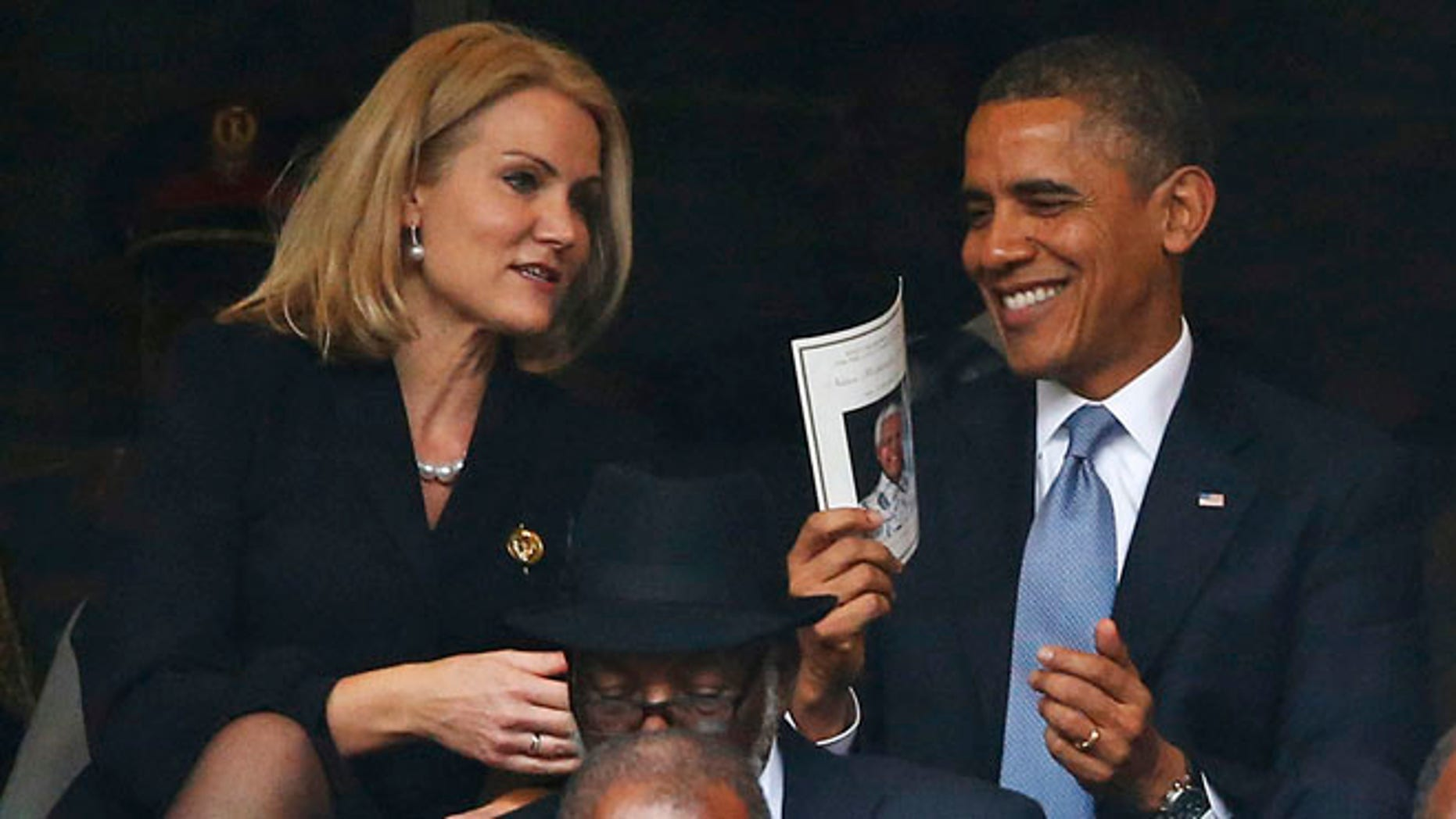 Dec. 10, 2013: President Barack Obama laughs with Danish prime minister, Helle Thorning-Schmidt, during the memorial service for former South African president Nelson Mandela at the FNB Stadium in Soweto, near Johannesburg, South Africa.