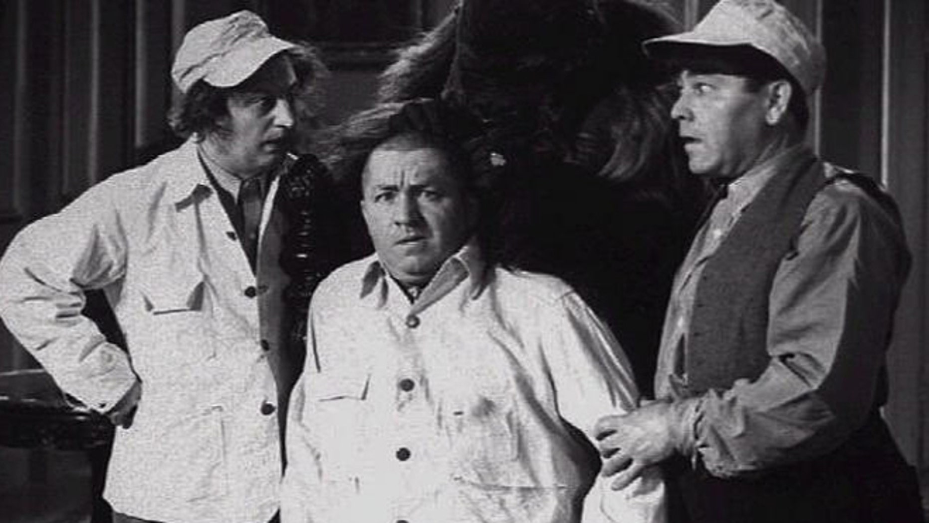 Larry Fine, Curly Jo De Rita, and Moe Howard in a scene from The Three Stooges movie.