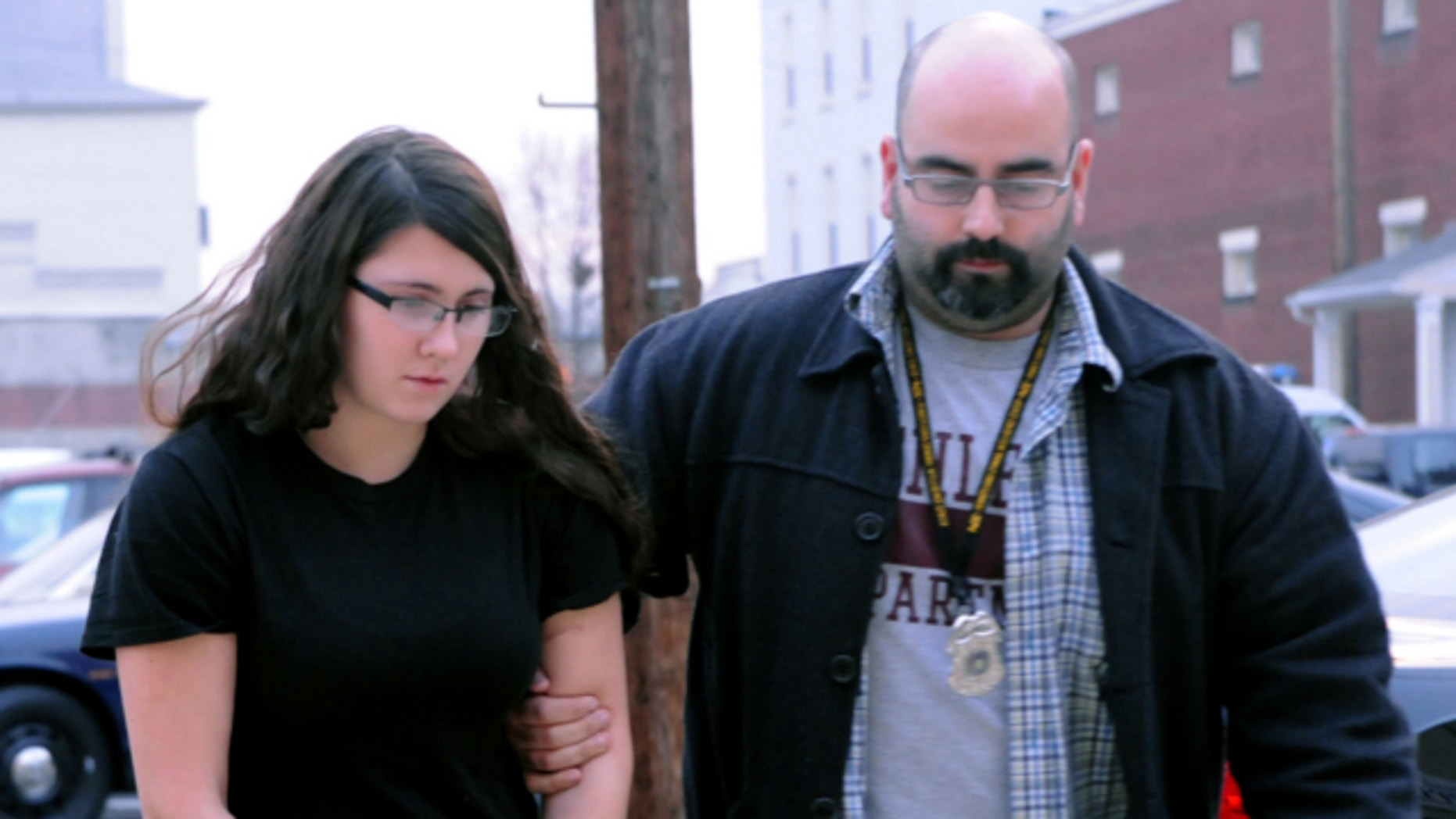 Dec. 3, 2013: Miranda K. Barbour is led into District Judge Ben Apfelbaum's office in Sunbury, Pa., by Sunbury policeman Travis Bremigen. Barbour is charged in the murder of Troy LaFerrara, whose body was found in a backyard in Sunbury, in November.