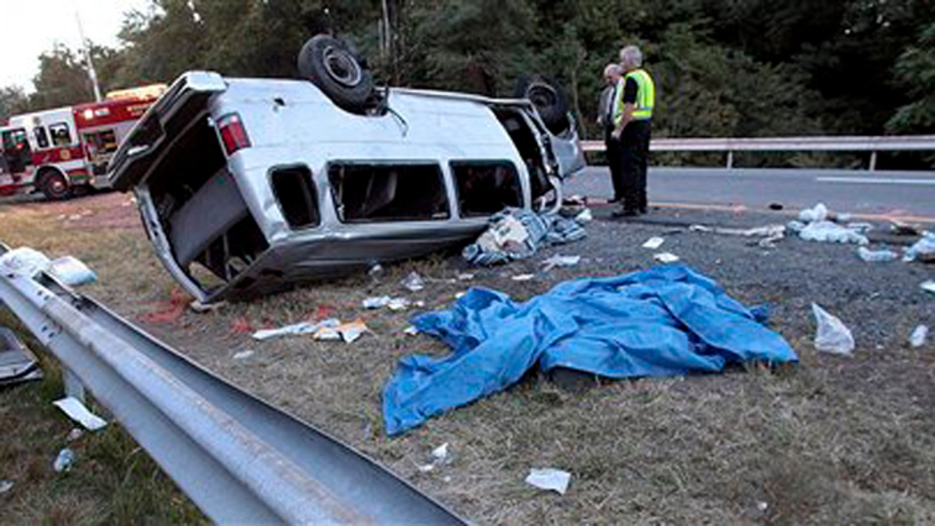Sept. 18, 2010: State police investigate the scene of a fatal accident in Woodbury, N.Y. A passenger van carrying members of a church flipped over on the New York State Thruway on Saturday, killing at least six people and injuring eight others, authorities said.