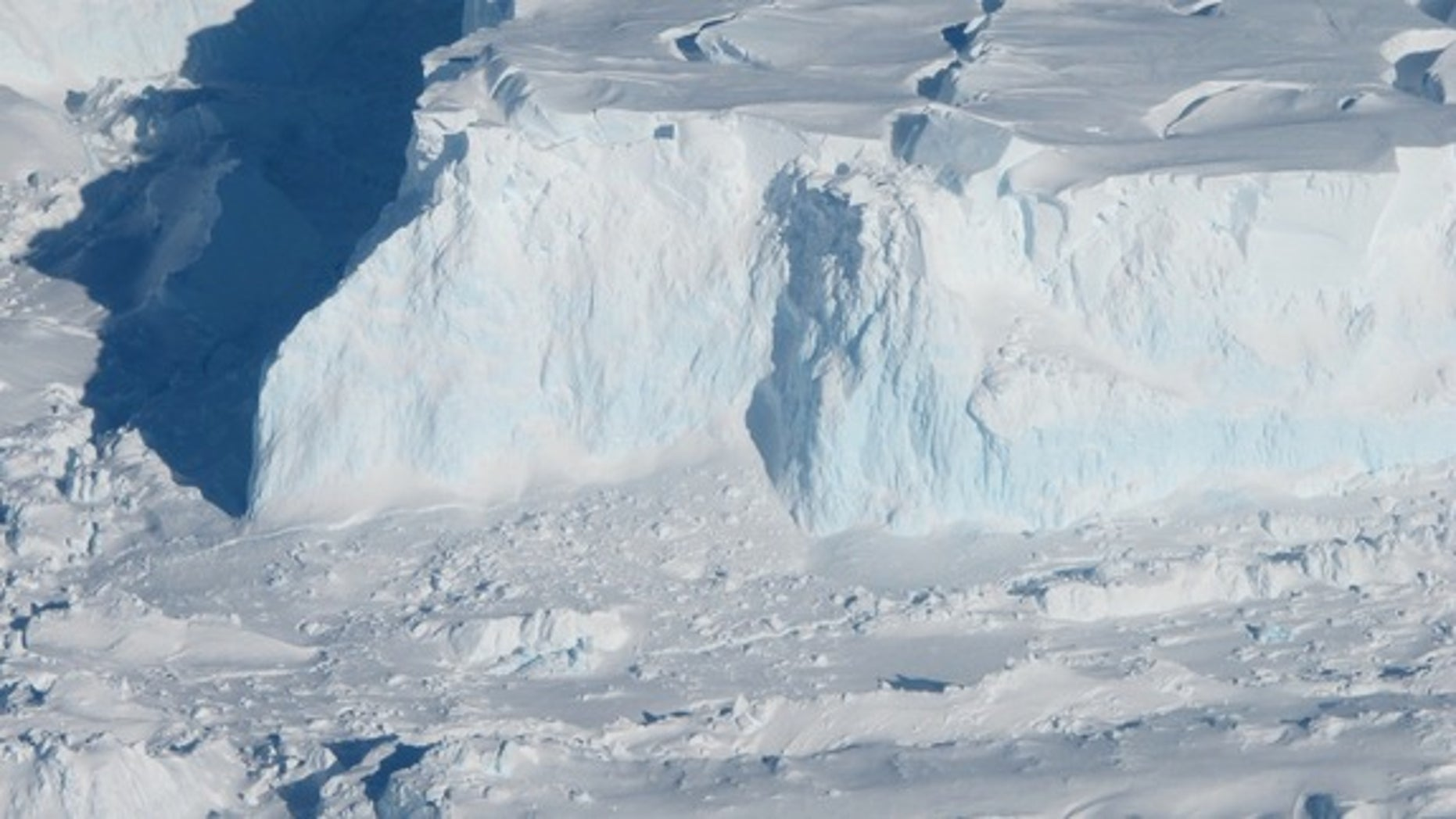 The edge of the Thwaites glacier, shown here in an image taken during Operation Icebridge, a NASA-led study of Antarctic and Greenland glaciers. The blue along the glacier front is dense, compressed ice.