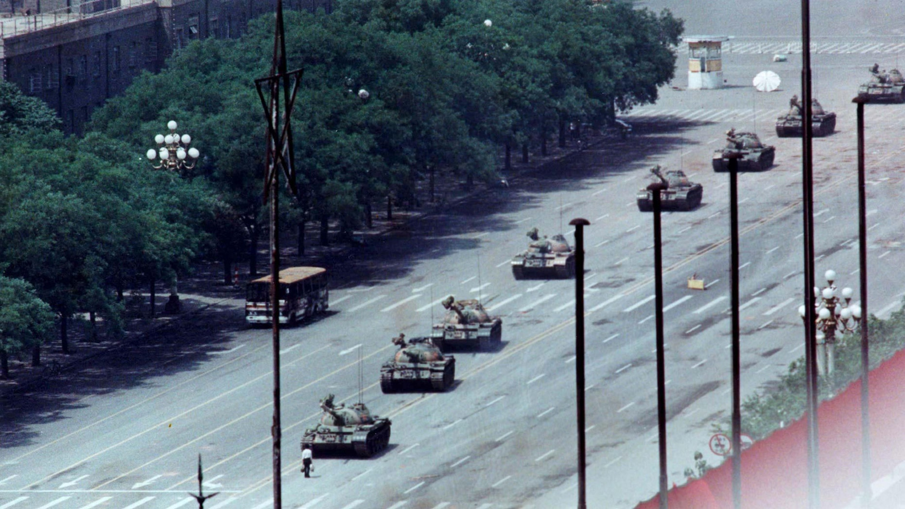 A man stands passively to block a column of army tanks on Changan Avenue east of Tiananmen Square in Beijing in this June 5, 1989 file photo. (REUTERS/Arthur Tsang/Files)
