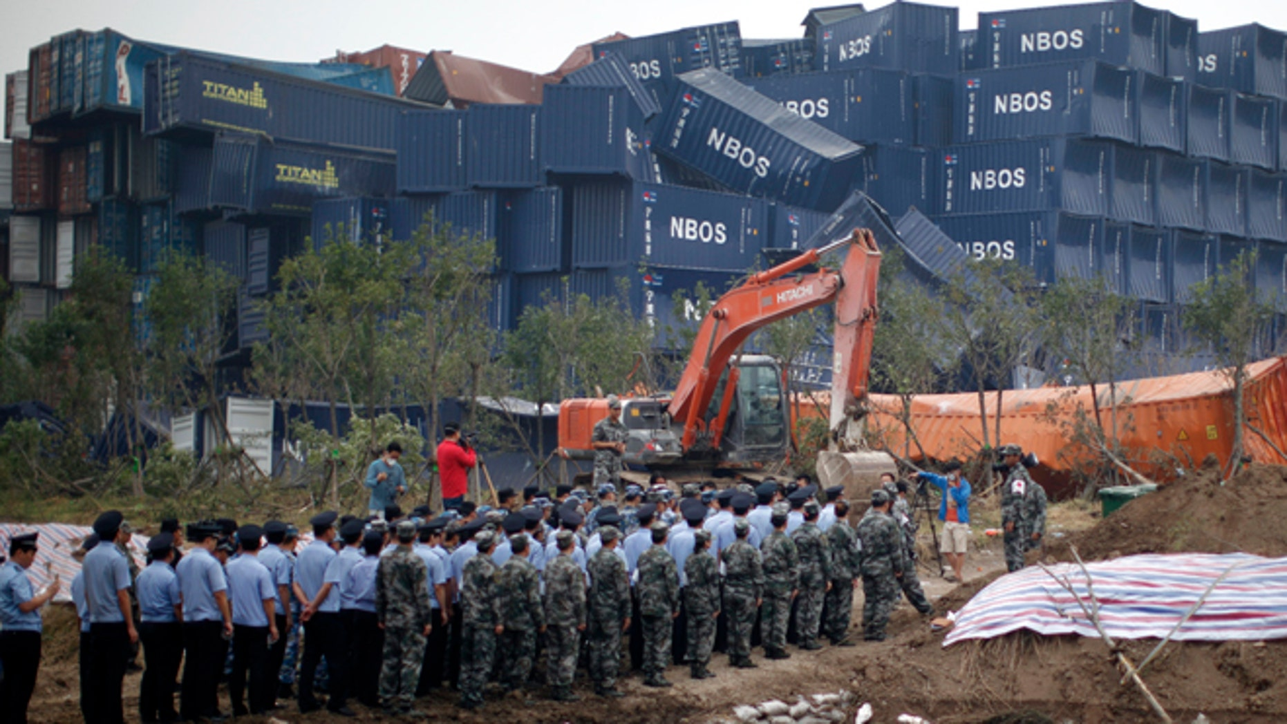 Aug. 18, 2015: Chinese soldiers, policemen and paramilitary policemen attend a memorial service for victims of the Tianjin blasts near the disaster's epicenter in northeastern China's Tianjin municipality.