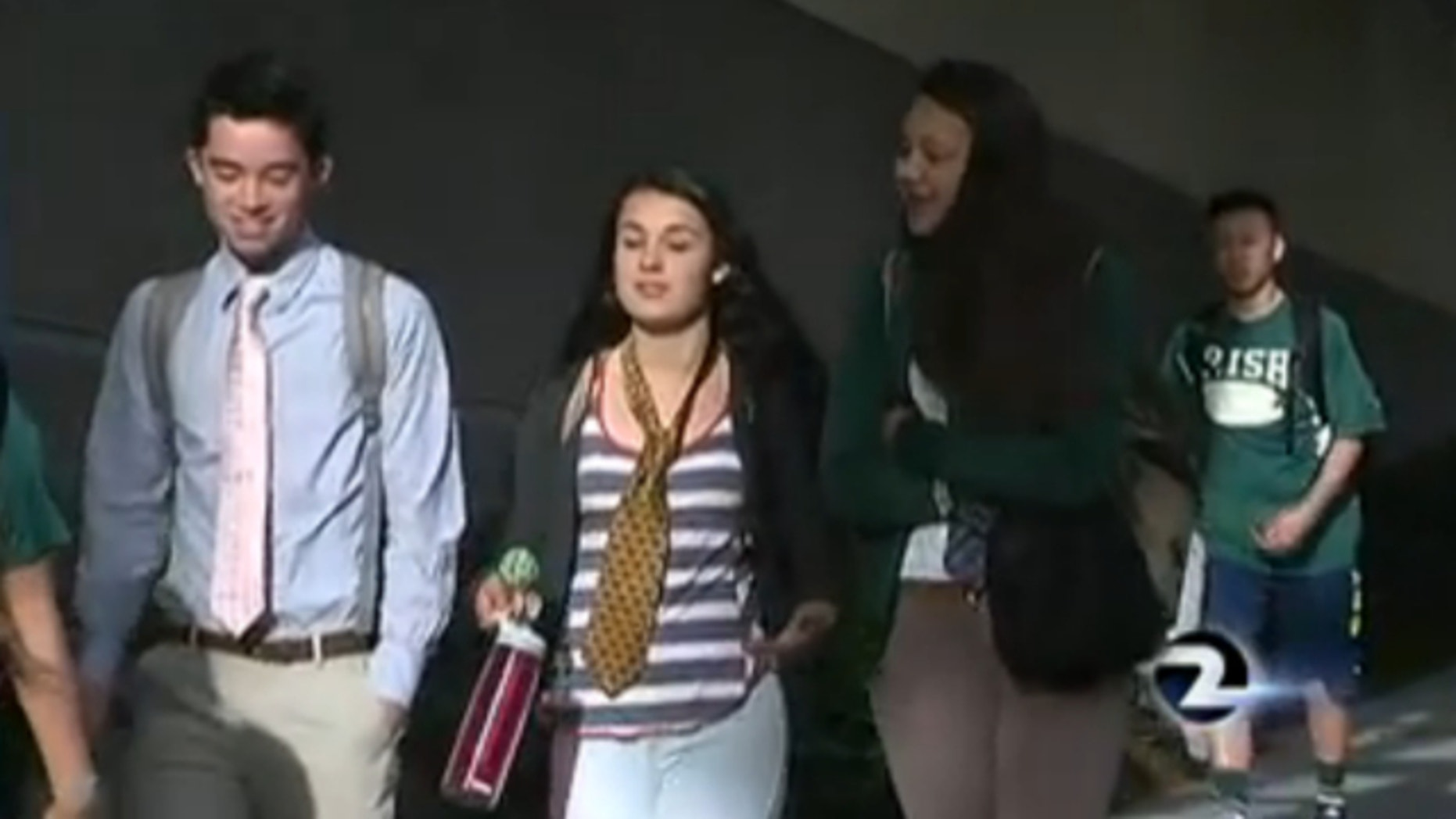 May 17, 2014: Students at Sacred Heart Cathedral Preparatory wore ties over their polo shirts and sweatshirts on campus to protest the administration's decision to omit senior Jessica Urbina's photo.